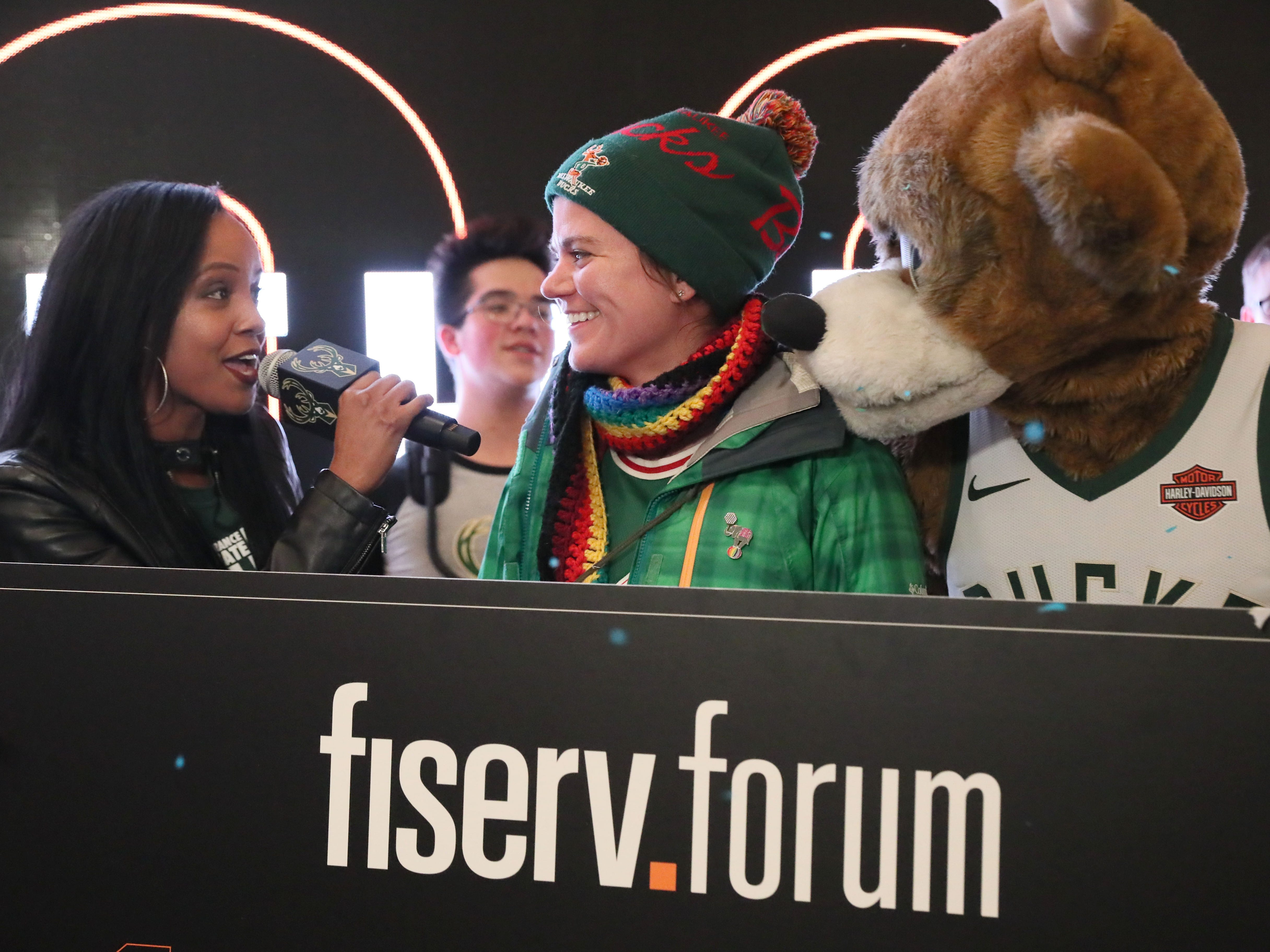 Bucks Tv personality Melanie Ricks (left) interviews the Fiserv Forum's millionth fan, Samantha Holschuh (center) of St. Francis, before the game Feb. 6 against the Washington Wizards.