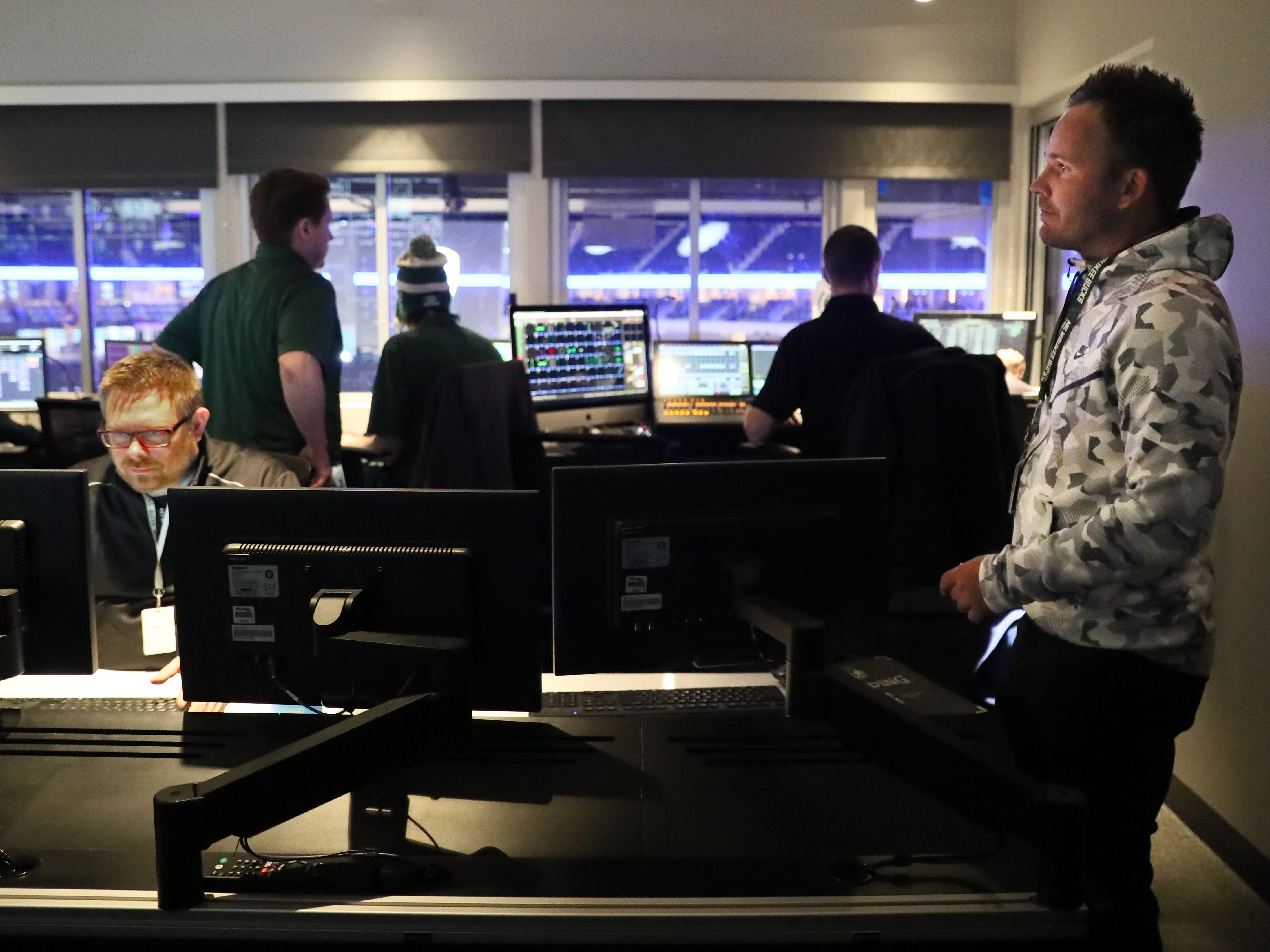Johnny Watson (right), the Milwaukee Bucks executive that in charge of all in-arena activities during games, meets before the game with the control room team. The team controls all audio and the scoreboard video.