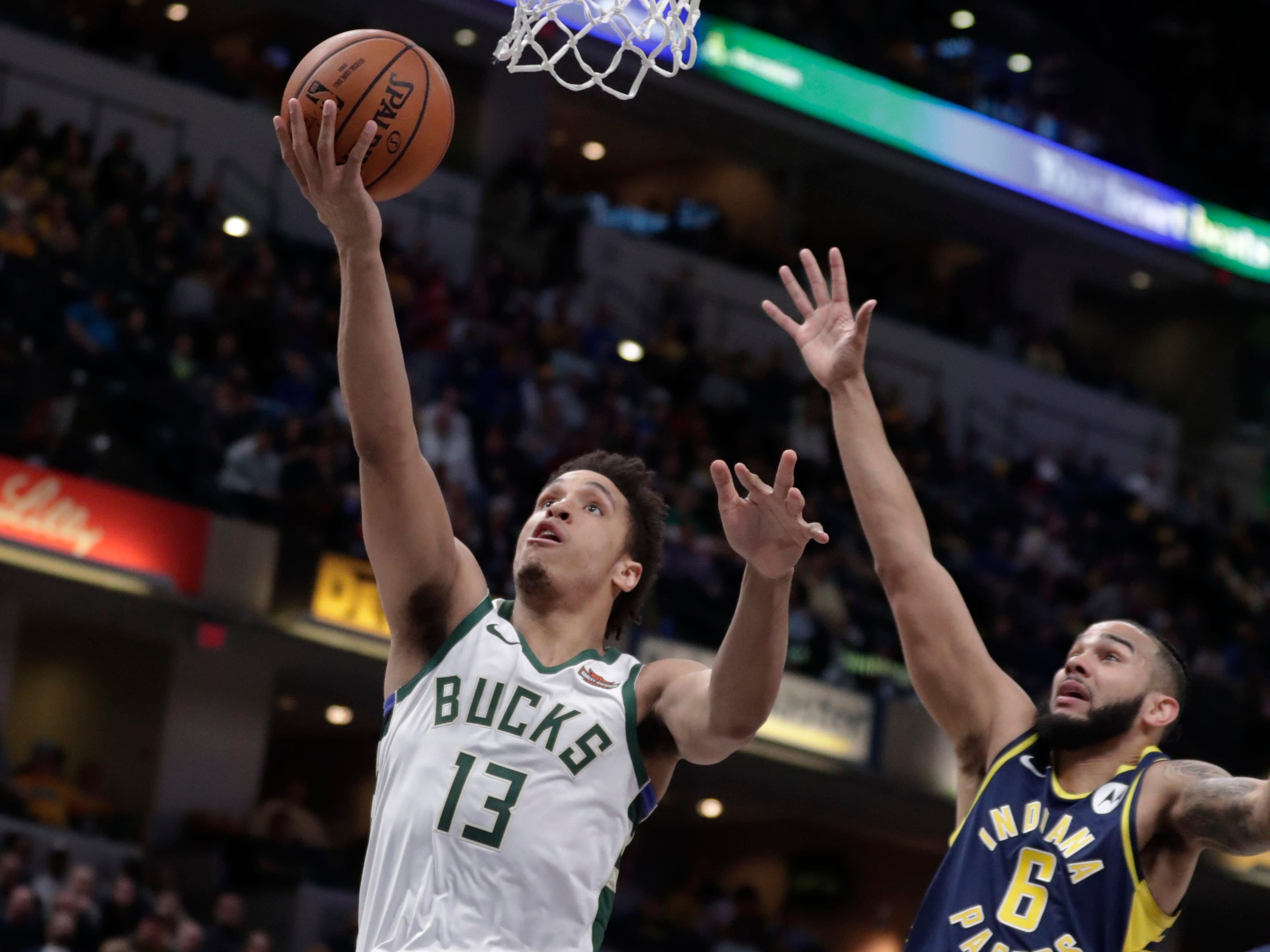 Bucks guard Malcolm Brogdon gets to the rim for a layup ahead of Pacers guard Cory Joseph during the second half Wednesday night.