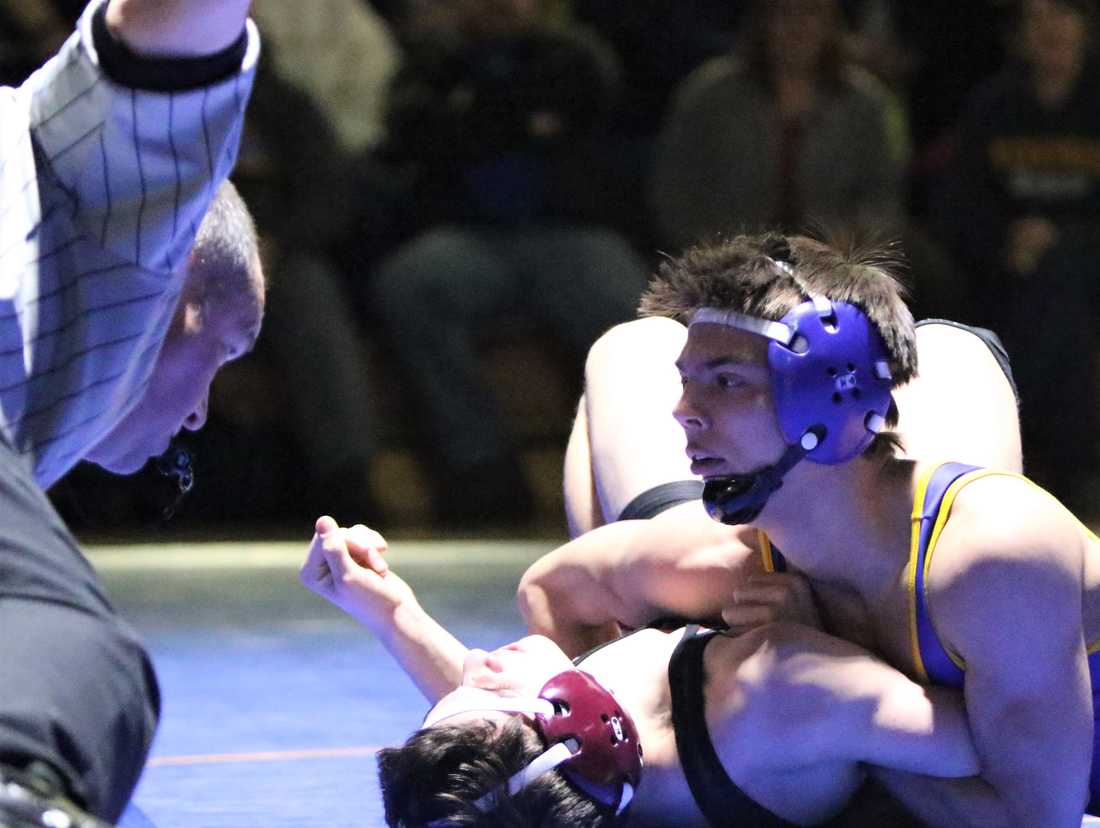 Mukwonago's Luke Eliszewski pins Wauwatosa's Luke Czaplewski in a 126-pound match in a WIAA sectional final on Feb. 13, 2019.