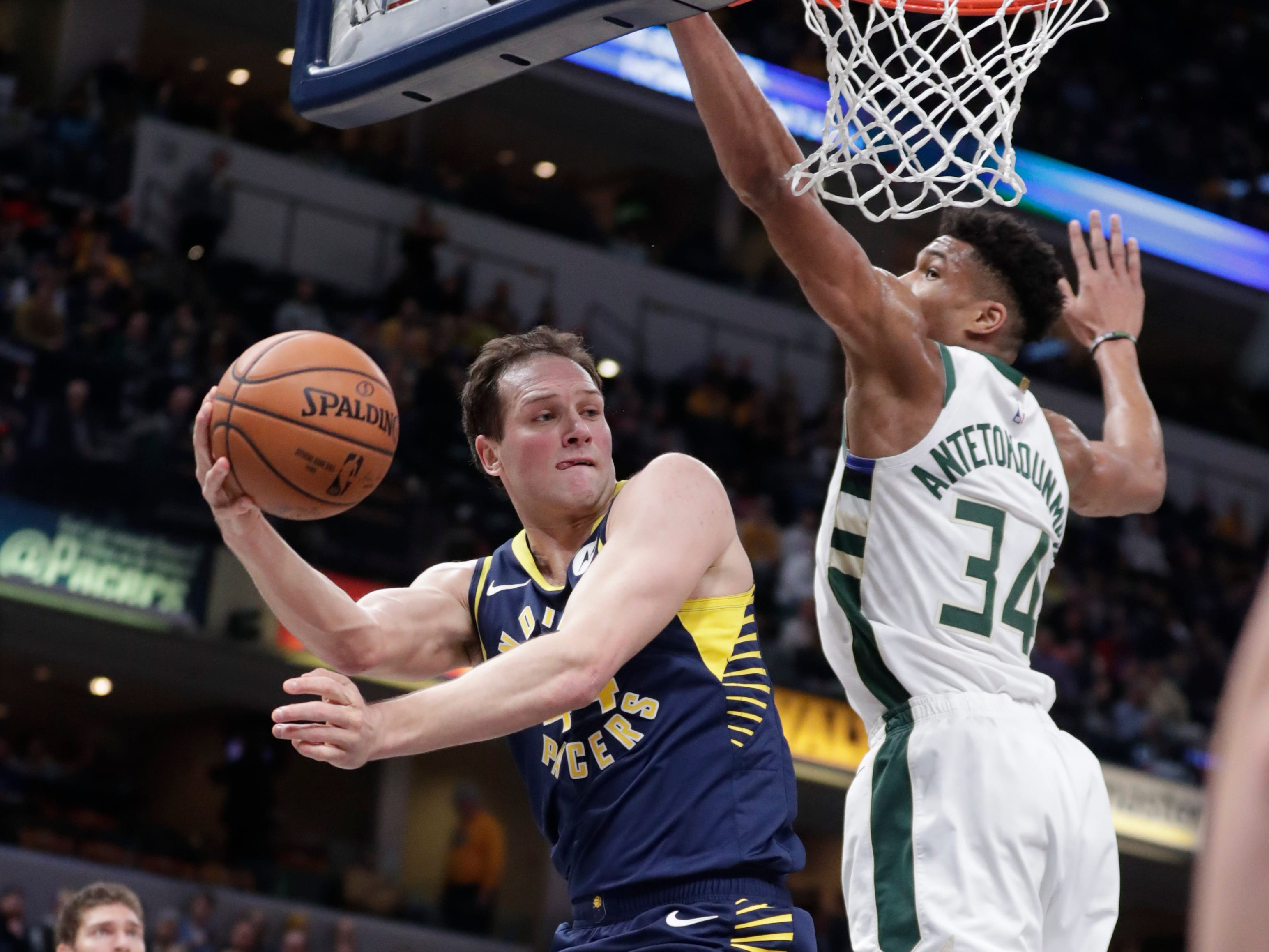 Pacers forward Bojan Bogdanovic is forced to kick a pass out to a teammate after Bucks forward Giannis Antetokounmpo made sure he couldn't get a shot off during the first half Wednesday.