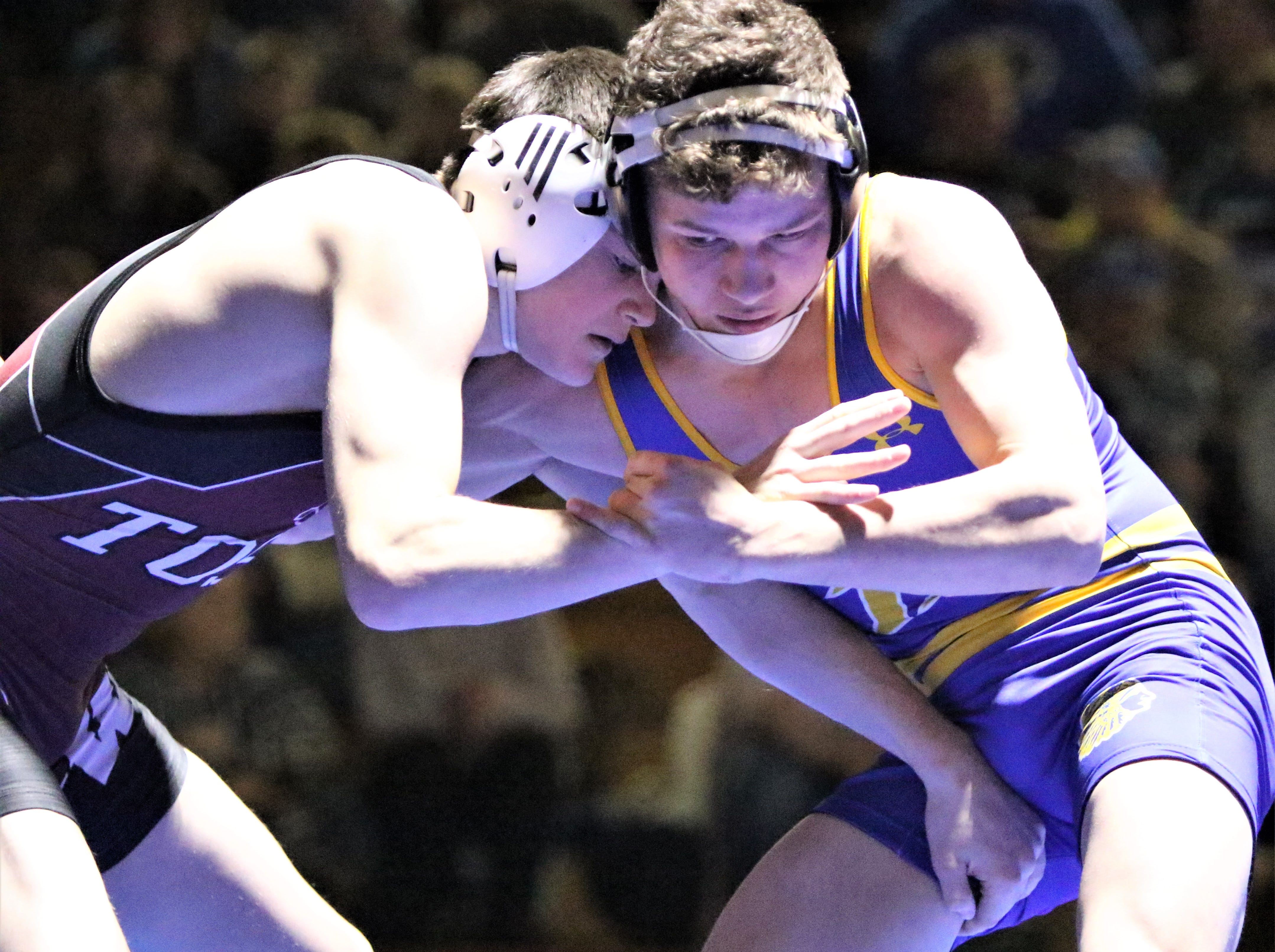 Mukwonago's Nate Stokhaug (right) wrestles against Wauwatosa's Ben Acker in a WIAA sectional final on Feb. 13, 2019.