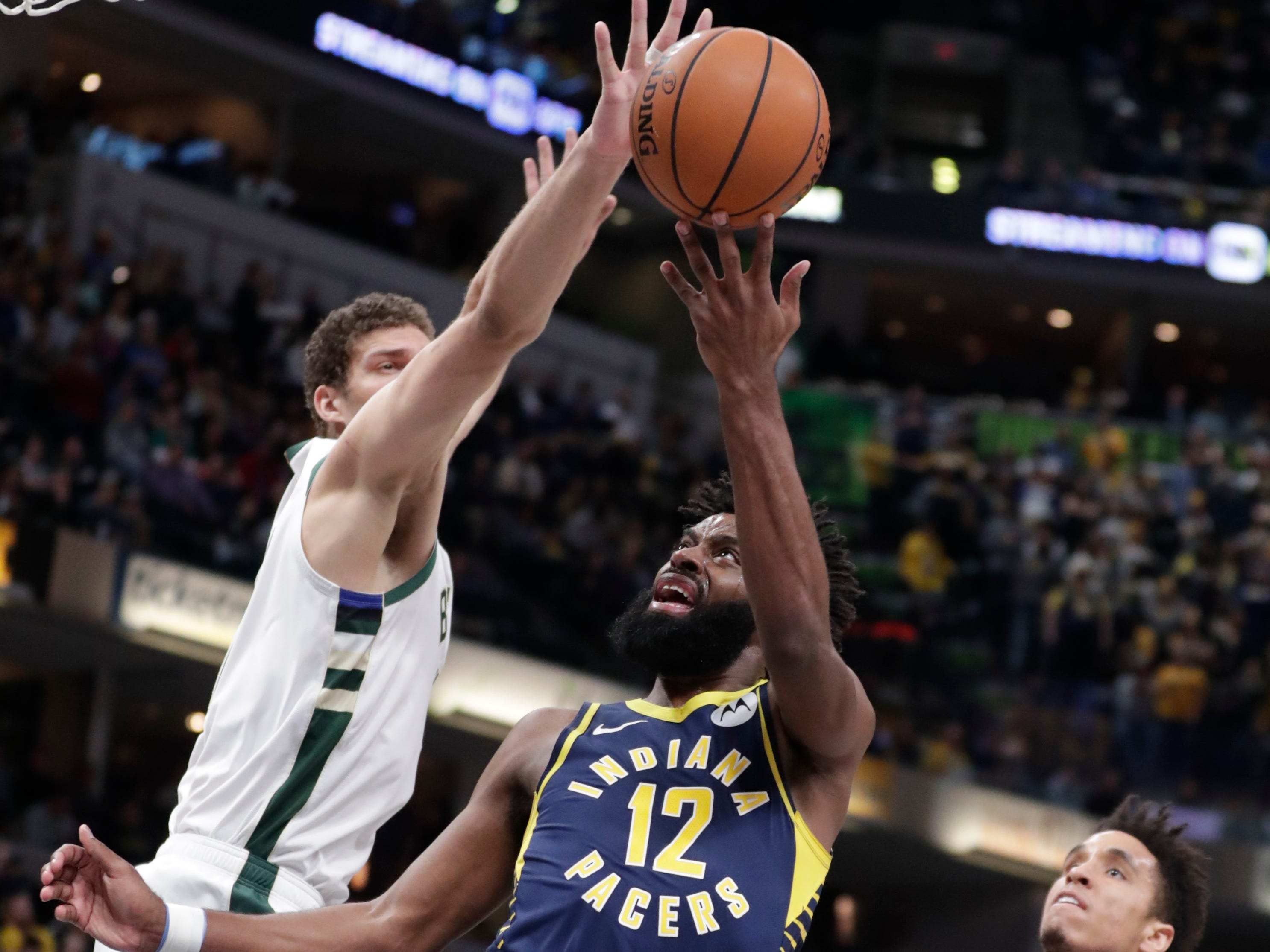 Bucks center Brook Lopez blocks the shot attempt of Pacers guard Tyreke Evans during the first half Wednesday.
