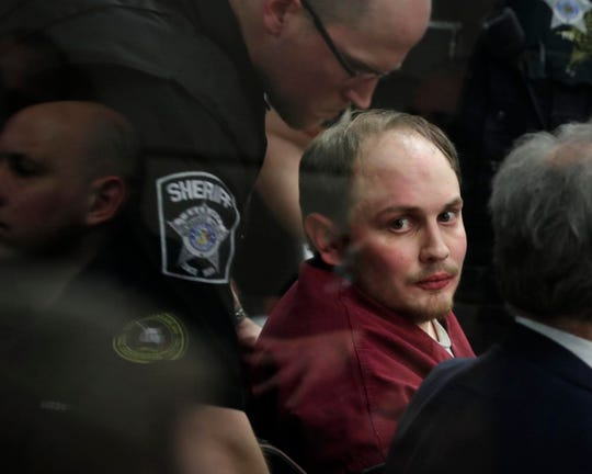Jordan Fricke, charged in the shooting death of Milwaukee Police Officer Matthew Rittner, looks back into the gallery during a court appearance Thursday morning at the Milwaukee County Criminal Justice Facility.