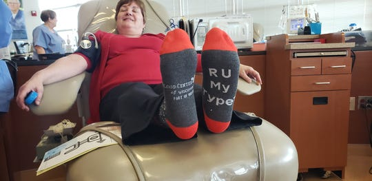 "Ann DeWitt shows off her socks which read, ""RU My TYPE"" while giving blood on Feb.14, 2019 at the Wauwatosa Blood Center of Wisconsin."