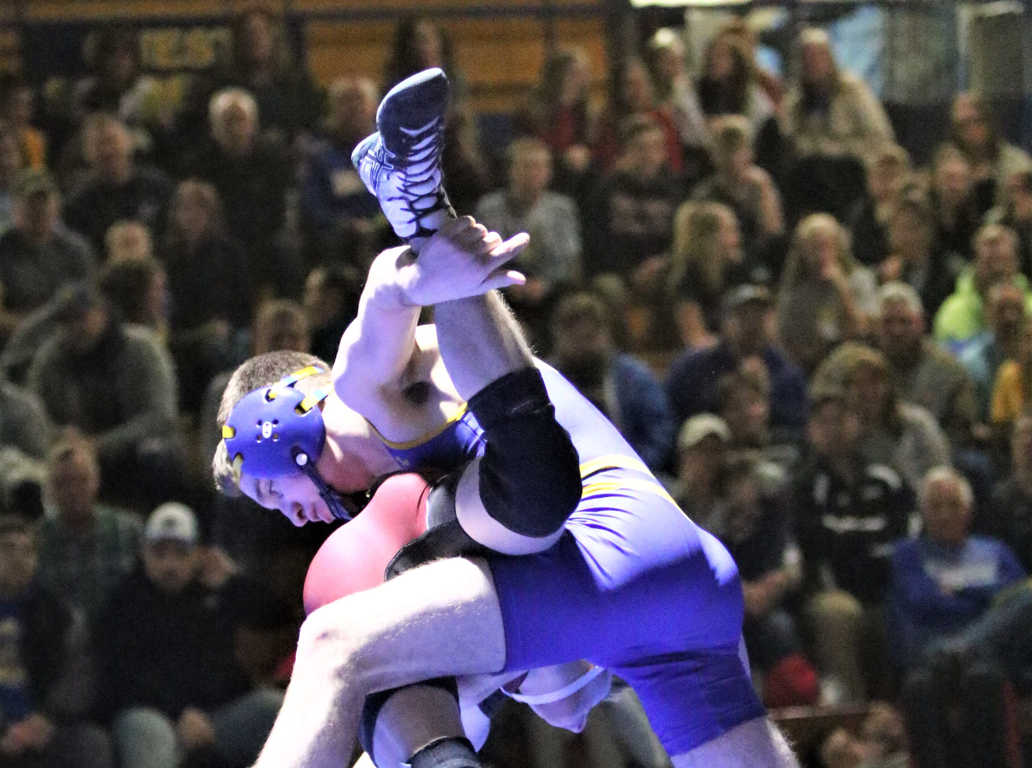 Mukwonago's Jake Wisinski takes down Wauwatosa's Elliott Tait during a match in a WIAA sectional final on Feb. 13, 2019.
