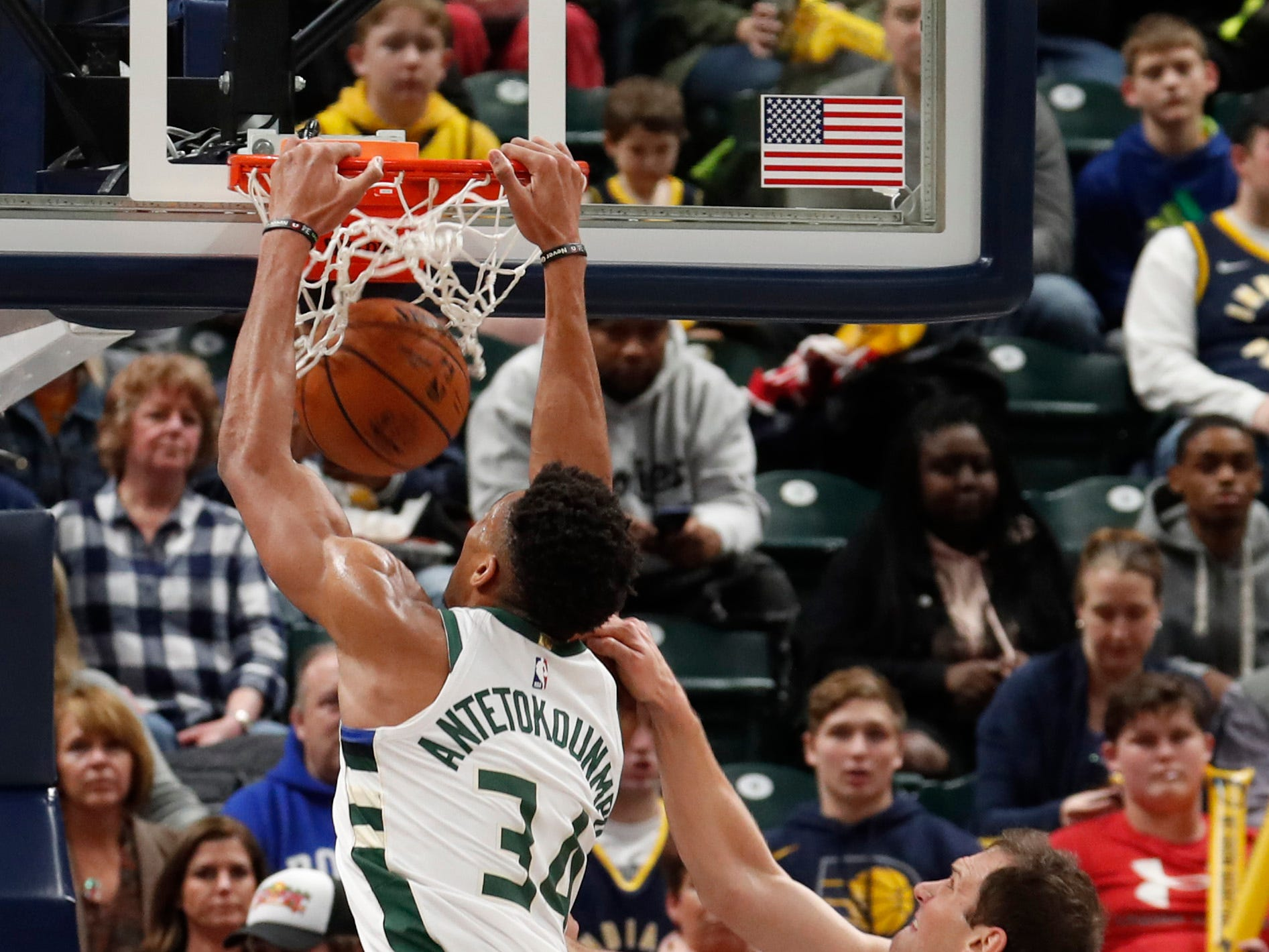 Bucks forward Giannis Antetokounmpo dunks against Pacers forward Bojan Bogdanovic during the first quarter Wednesday night.