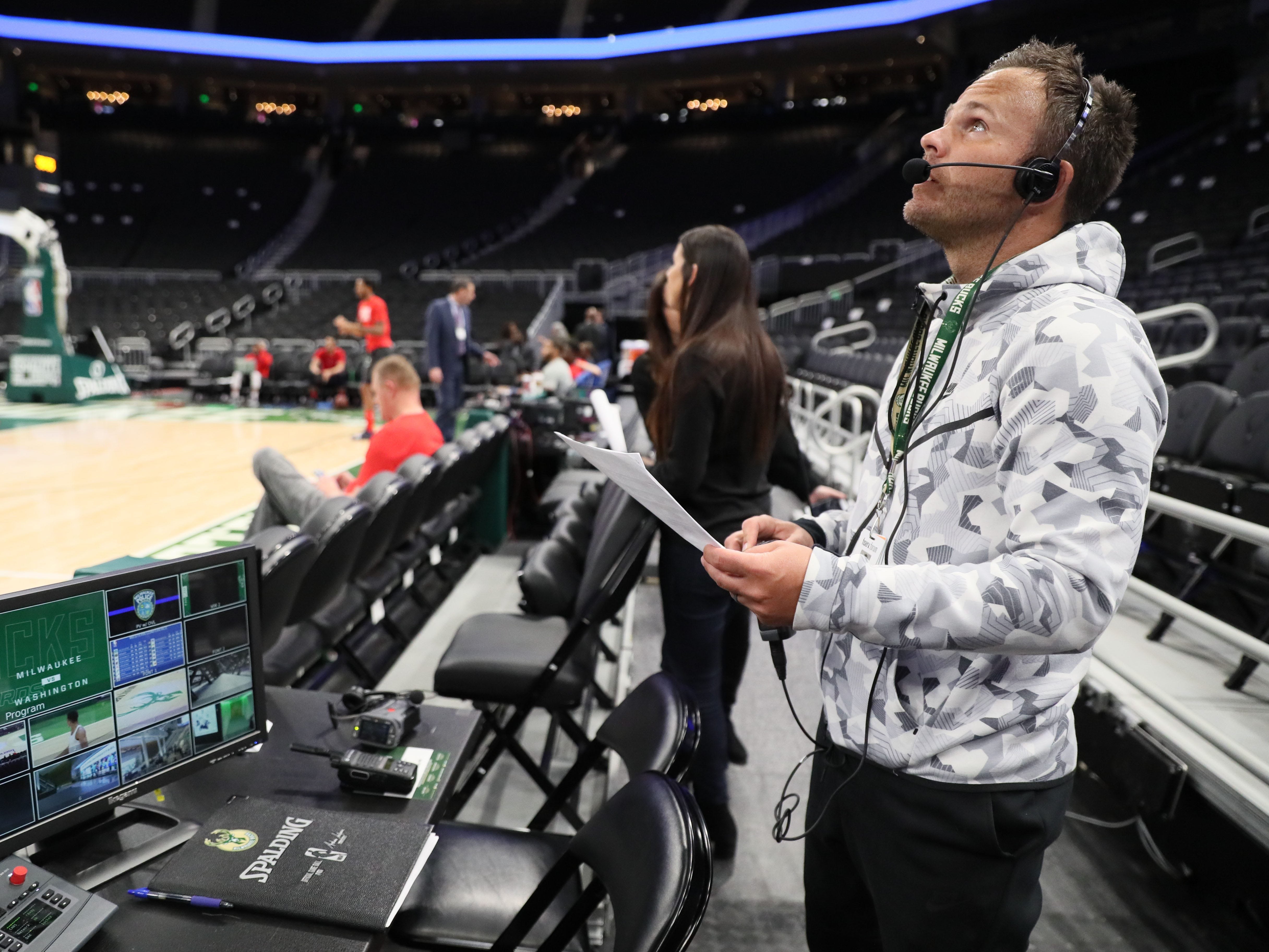 johnny Watson, the Milwaukee Bucks'  director of live programming and entertainment, goes over cues on the scoreboard with the control room team before the Bucks game against the Washington Wizards on Feb. 6. Watson's job is to make sure fans are entertained during breaks in the action and build excitement that Bucks players can feed off.