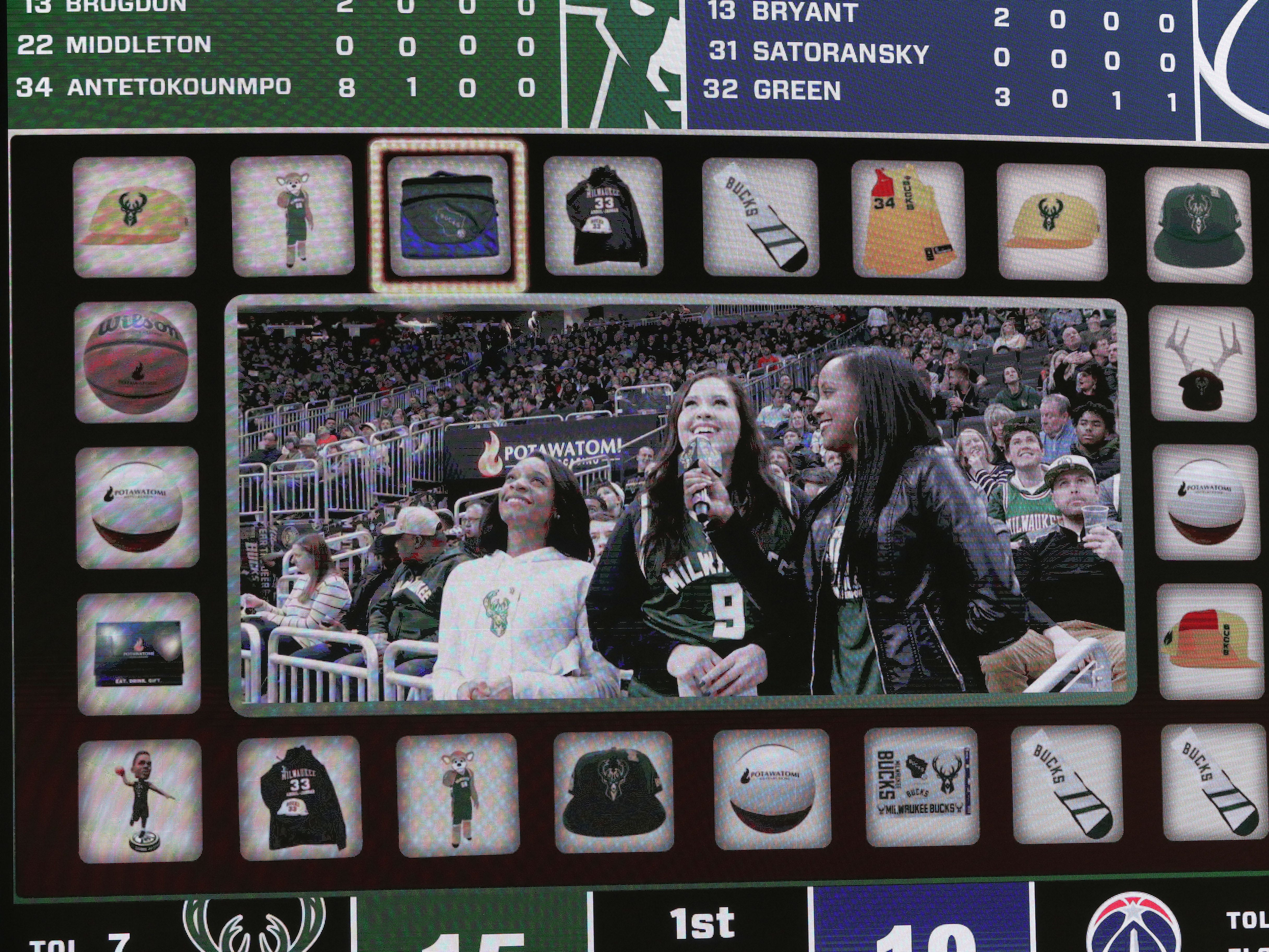 """Games playing out on the scoreboard are all part of the entertainment package during Bucks games.  These fans play """"Press Your Luck"""" on Feb. 6."""