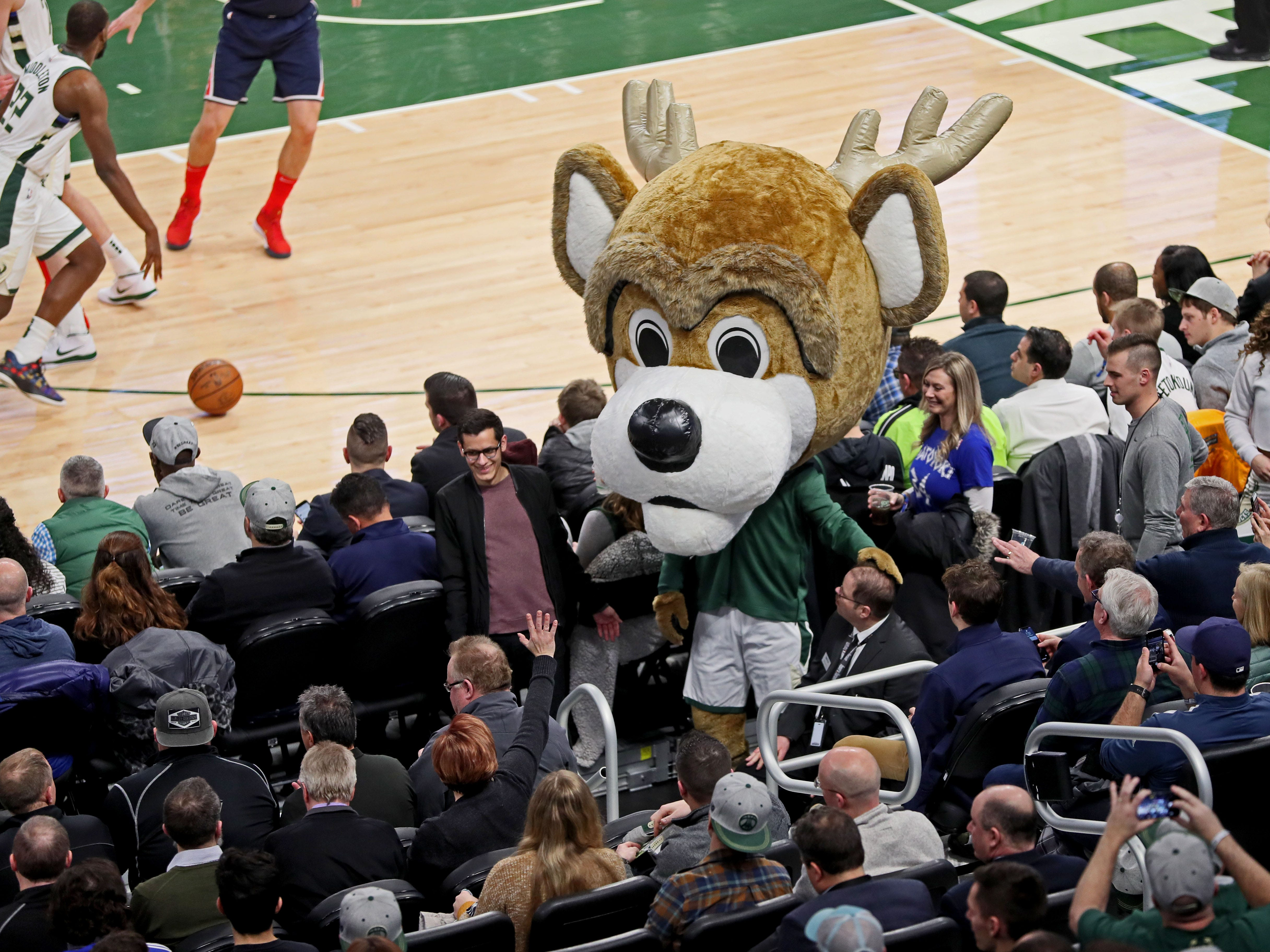 Wearing an even more oversized head than his normal oversized head, Bango  works the crowd.