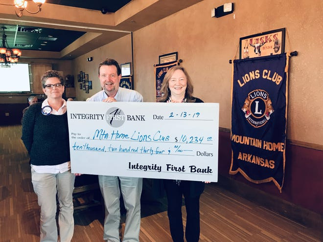 The Adeline Dvorak Trust administered byIntegrity First Bank Trust & Wealth Management Services recently donated $10,234 to the Mountain Home Lion's Club. Pictured are: (from left) Carolyn Chentik,Mountain Home Lion's Club Membership Co-Chair;George Truell, President of the Mountain Home Lion's Club; andJanet Evans, VP Trust Officer with Integrity First Bank.