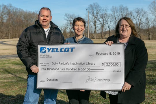 Yelcot Communications recently provided a $2,500 sponsorship to bring the Dolly Parton's Imagination Library to Marion County. Pictured are: (from left) Yellville Mayor Shawn Lane, Imagination Library representative Lea Autumn and Yelcot President Sara Zimmerman.