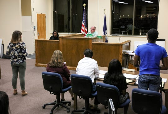 ULM mock trial team students participate in mock courtroom proceedings.