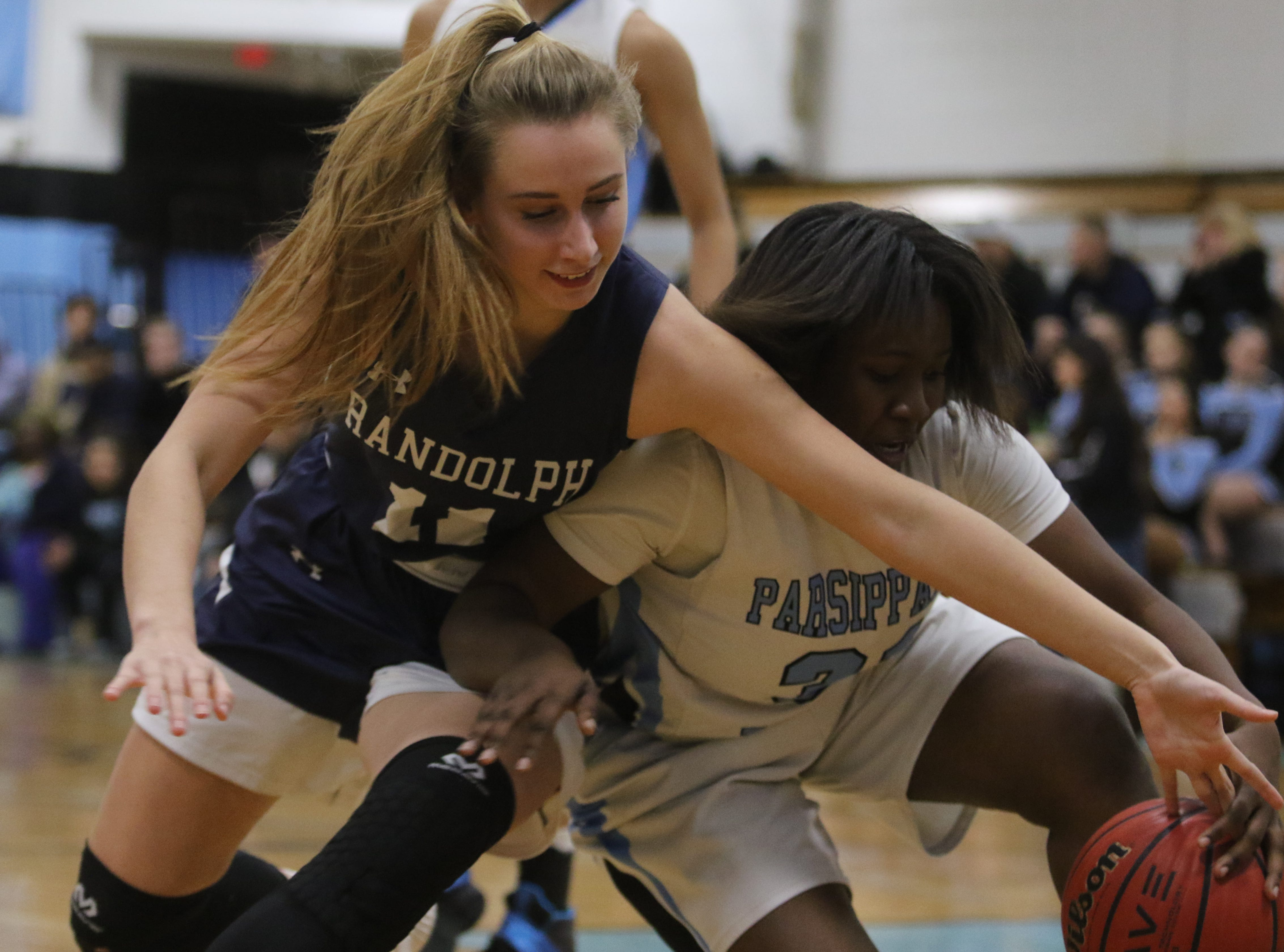 Randolph sophomore Petra Csanyi (left) goes for the ball with Nadriah Freeman of Parsippany Hills in the second half.