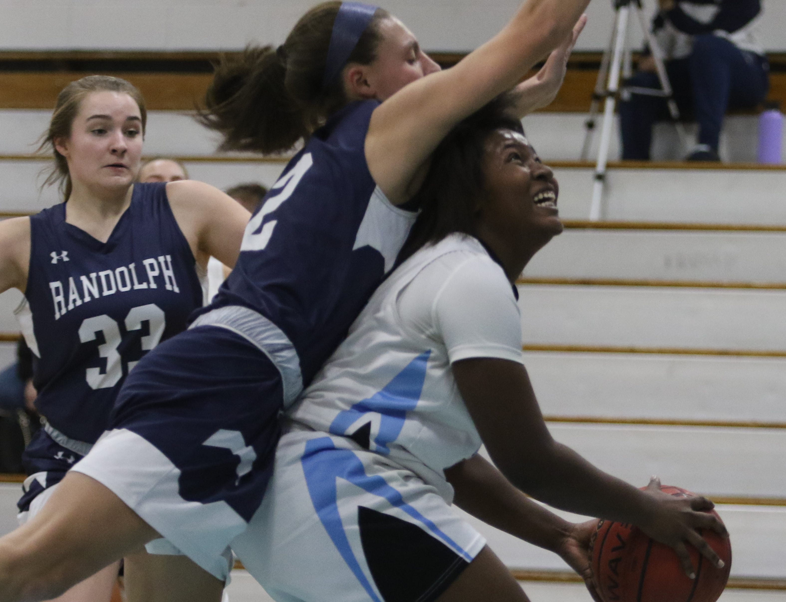 Alyssa Alfieri of Randolph fouls Nadriah Freeman of Parsippany Hills on the this second half play.