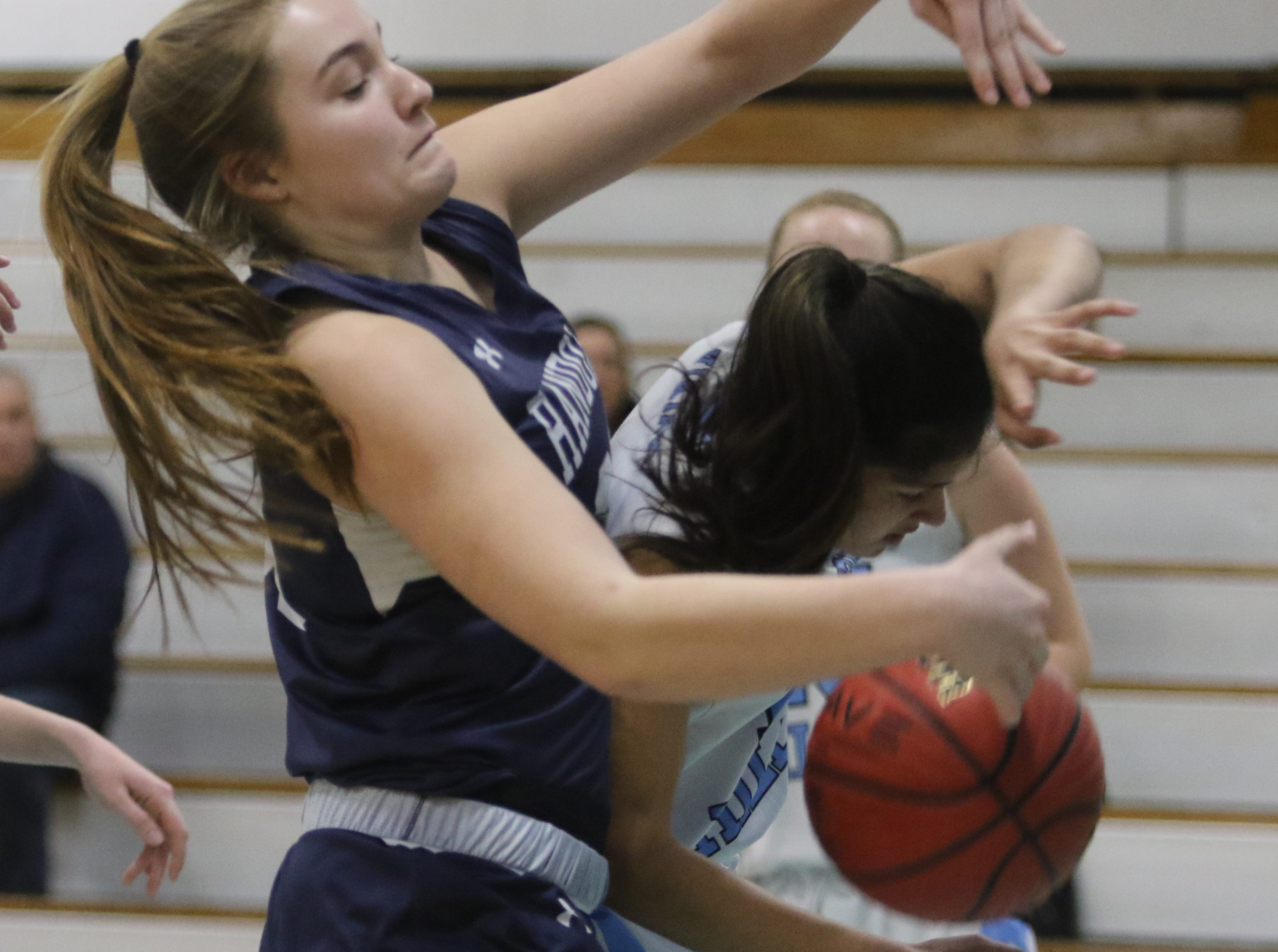 Olivia Turner of Randolph fights for the rebound with Kelsey Morgan of Parsippany Hills in the first half.