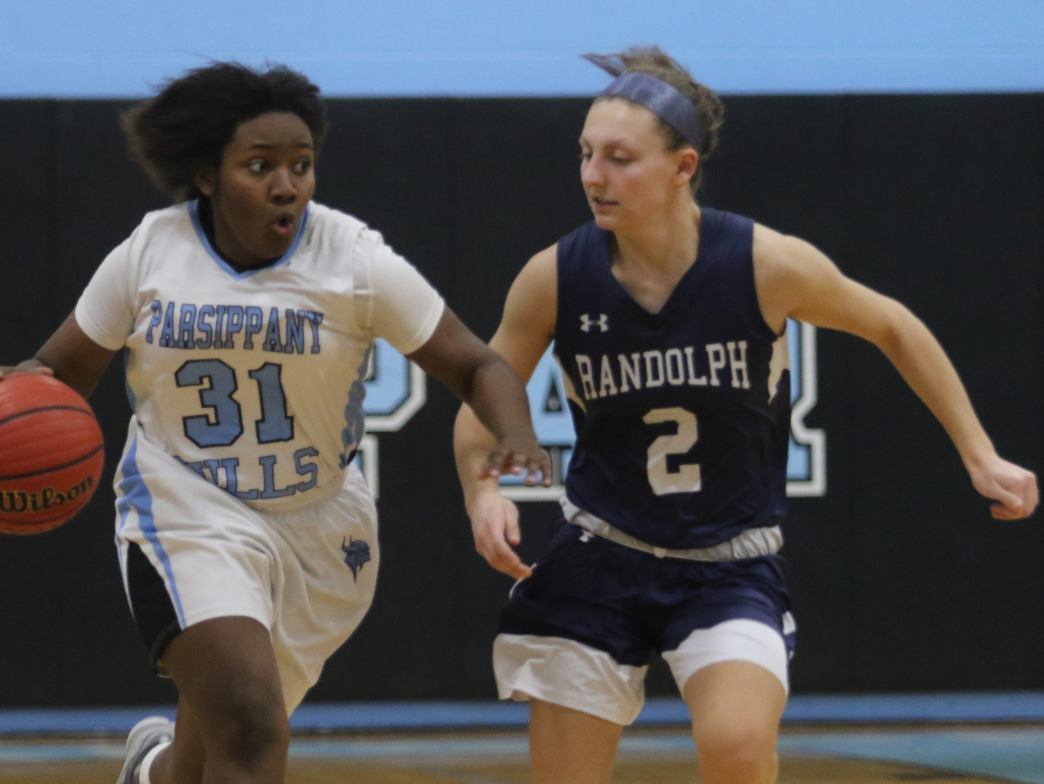 Nadriah Freeman of Parsippany Hills dribbles the ball down court while being guarded by Alyssa Alfieri of Randolph in the first half.