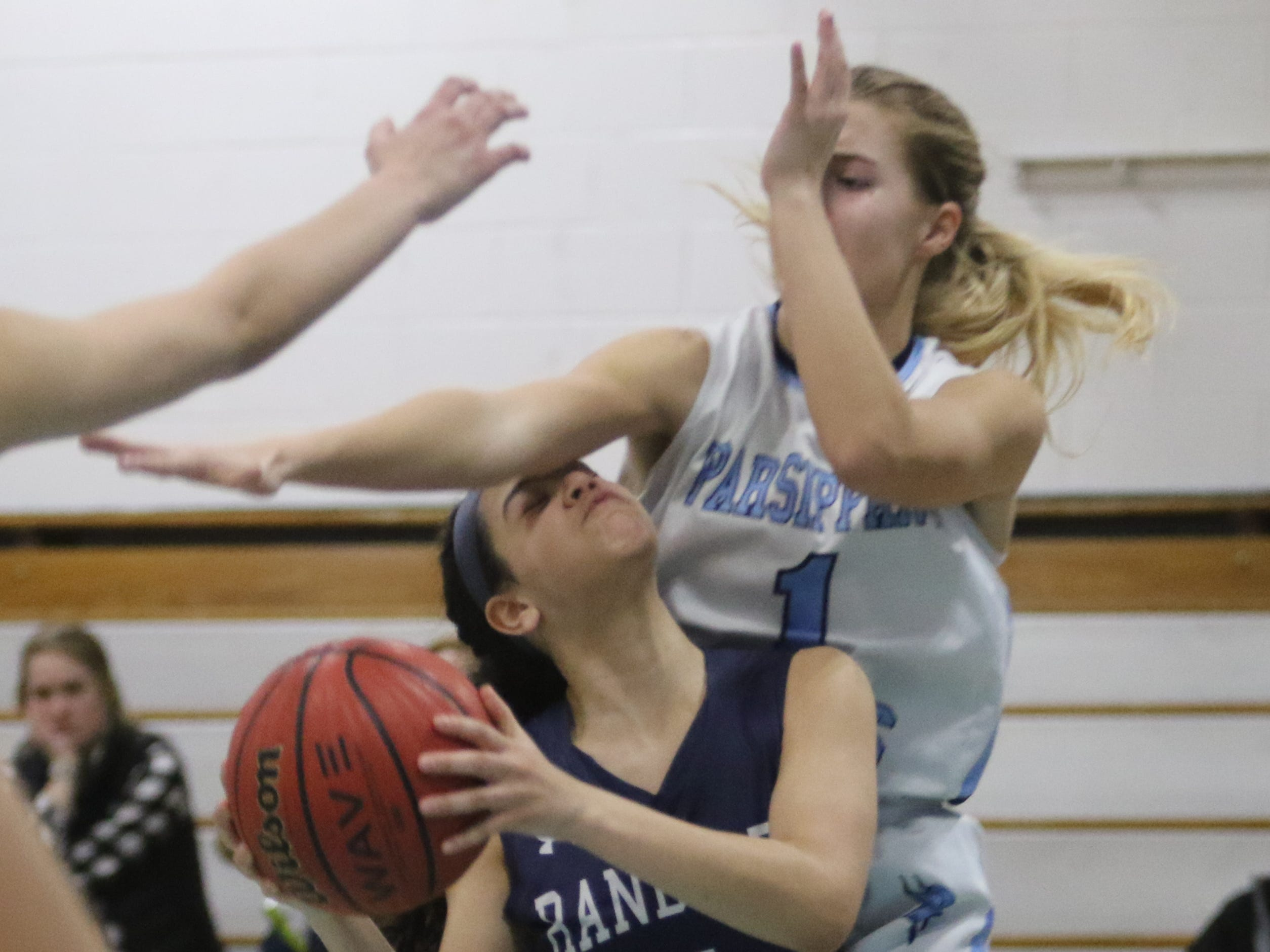 Angeleen Mulero of Randolph is fouled by Jaclyn Carifi of Parsippany Hills in the second half.