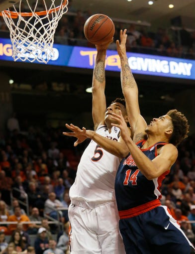 Feb 13, 2019; Auburn, AL, USA;  Auburn Tigers forward Chuma Okeke (5) takes a shot against Ole Miss Rebels forward KJ Buffen (14) during the second half at Auburn Arena. Mandatory Credit: John Reed-USA TODAY Sports