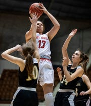 Pleasant Home's River Baldwin shoots over Westminster Oak Mountain's Macy Mixon and Westminster Oak Mountain's Megan Gache In AHSAA Regional basketball action at Garrett Coliseum in Montgomery, Ala., on Thursday February 14, 2019.