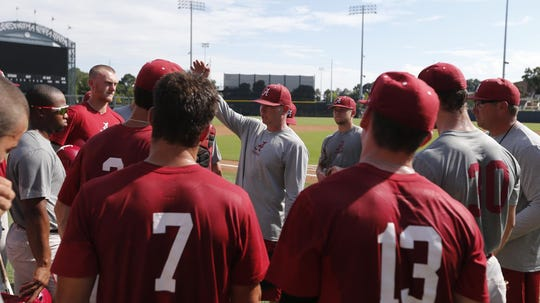 Alabama head baseball coach Brad Bohannon speaks to his players after a recent spring practice inside Sewell-Thomas Stadium in Tuscaloosa, Alabama. (Photo courtesy of Alabama athletics)