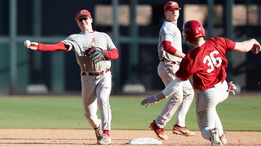 Alabama second baseman Morgan McCullough turns a double play during a recent spring practice inside Sewell-Thomas Stadium in Tuscaloosa. (Photo courtesy of Alabama athletics)