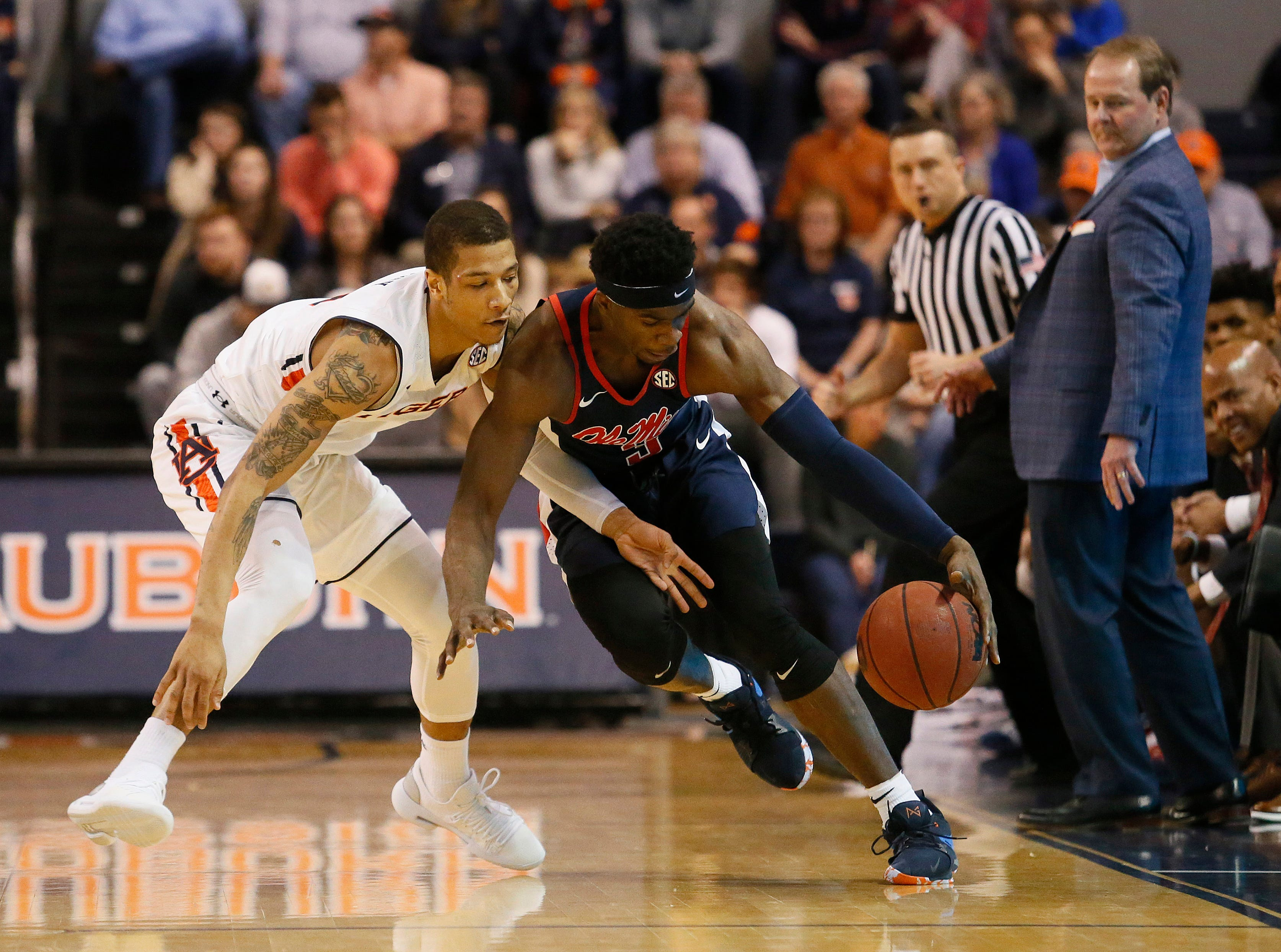 Feb 13, 2019; Auburn, AL, USA;  Ole Miss Rebels guard Terence Davis (3) and Auburn Tigers guard Samir Doughty (10) go for the ball during the second half at Auburn Arena. Mandatory Credit: John Reed-USA TODAY Sports