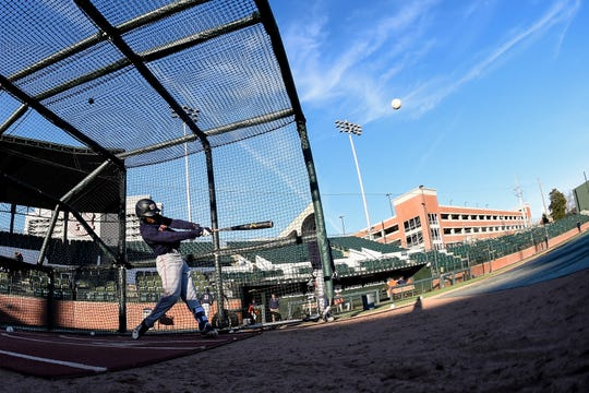 Auburn second baseman Ryan Bliss takes batting practice.
