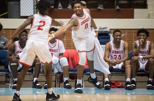 Lee guard Demarshia Davis (2) and forward Demond Robinson (0) joke around in the final minutes of the game during the Class 7A Southeast Regional semifinals in Montgomery, Ala., on Thursday, Feb. 14, 2019. Lee defeated Smiths Station 91-50.