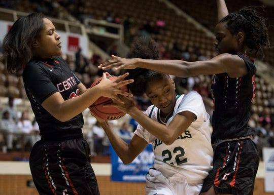 Central-Phenix City's Alleya King, left, and Jeff Davis' Carmen Williams, middle fight for the ball during the Class 7A Southeast Regional semifinals in Montgomery, Ala., on Thursday, Feb. 14, 2019.