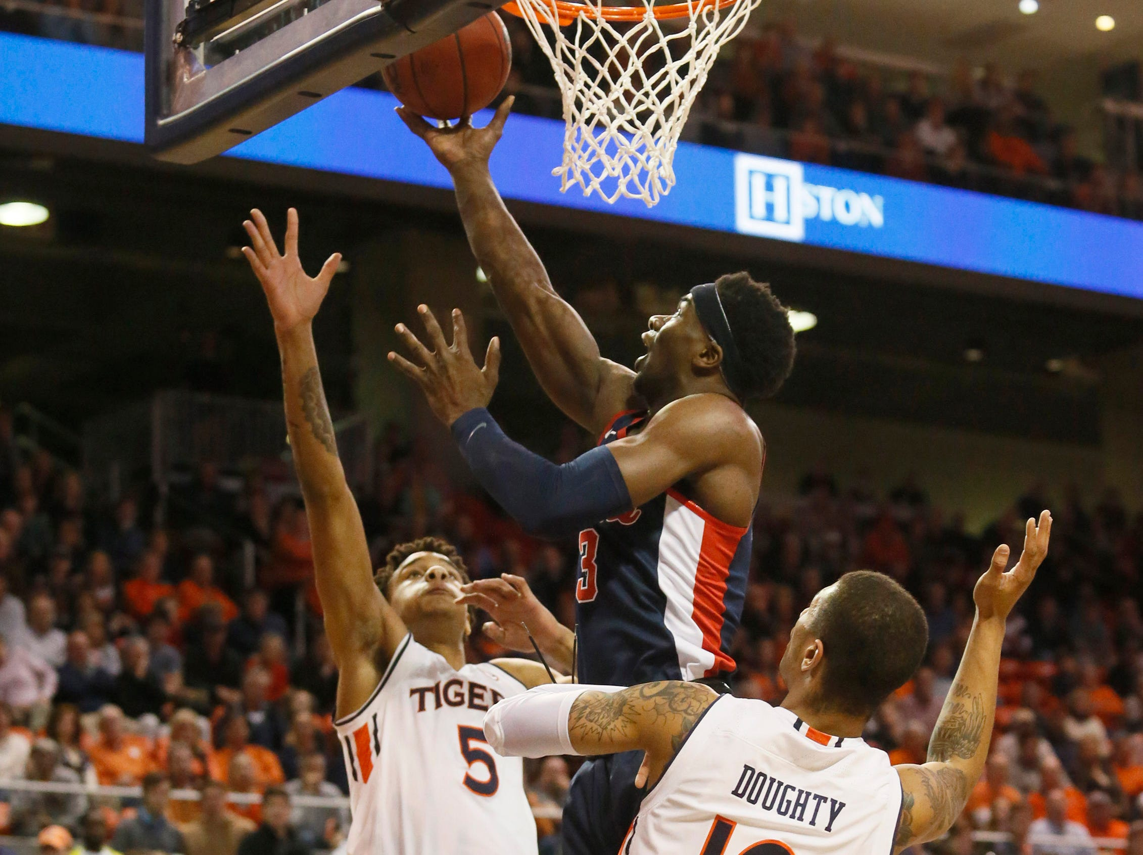Feb 13, 2019; Auburn, AL, USA; Ole Miss Rebels guard Terence Davis (3) takes a shot between Auburn Tigers forward Chuma Okeke (5) and guard Samir Doughty (10) during the first half at Auburn Arena. Mandatory Credit: John Reed-USA TODAY Sports