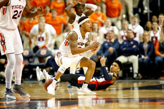 Feb 13, 2019; Auburn, AL, USA;  Auburn Tigers guard Bryce Brown (2) reacts after being whistled for a foul on Ole Miss Rebels guard Breein Tyree (4) during the second half at Auburn Arena. Mandatory Credit: John Reed-USA TODAY Sports