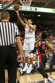 Auburn forward Chuma Okeke (5) takes a shot over Ole Miss  guard Breein Tyree (4) during the second half at Auburn Arena on Feb. 13, 2019.