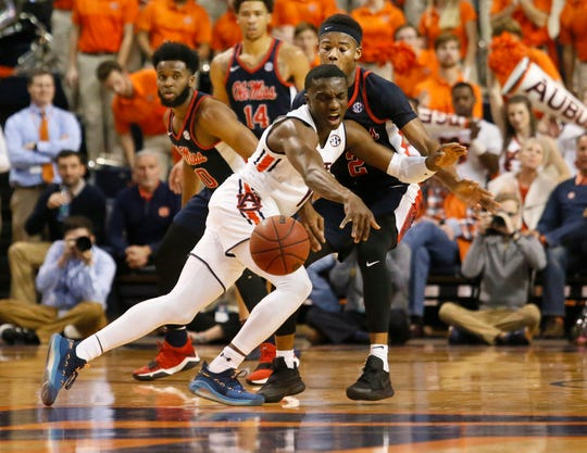Auburn guard Jared Harper (1) reacts after being fouled by Ole Miss guard Devontae Shuler (2) during the first half at Auburn Arena.