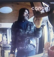 Madison County authorities released this image of an intruder who ransacked a house north of Chesterfield on Sunday. On Tuesday, authorities arrested Muncie resident Darryl Rogers in the break-in.