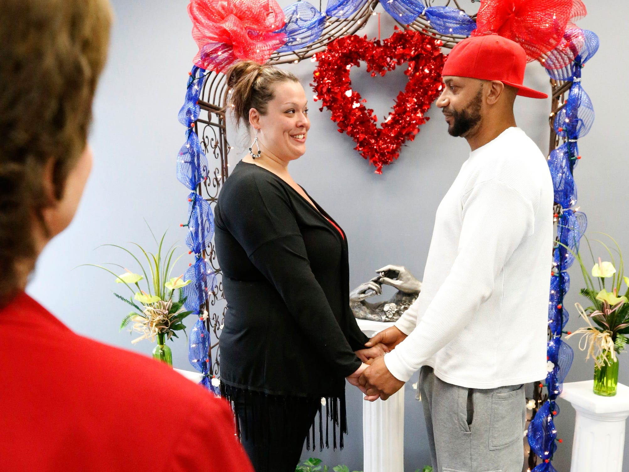 Kimberly (Ervin) Aiden and Shermaine Aiden are married by Mollie Slaybaugh at the Marry Me of Tennessee Wedding Chapel on Valentine's Day on Thursday, Feb. 14, 2019.