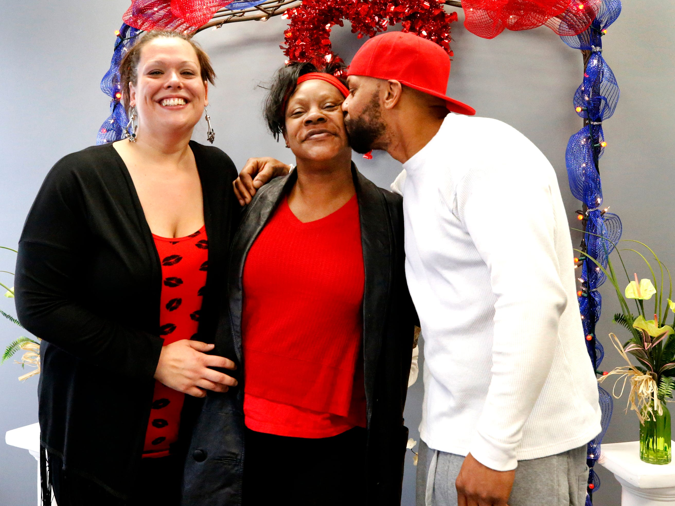 Via King, center is photographed with her nephew Shermaine Aiden, right and his new wife Kimberly (Ervin) Aiden after they were married by Mollie Slaybaugh at the Marry Me of Tennessee Wedding Chapel on Valentine's Day on Thursday, Feb. 14, 2019.
