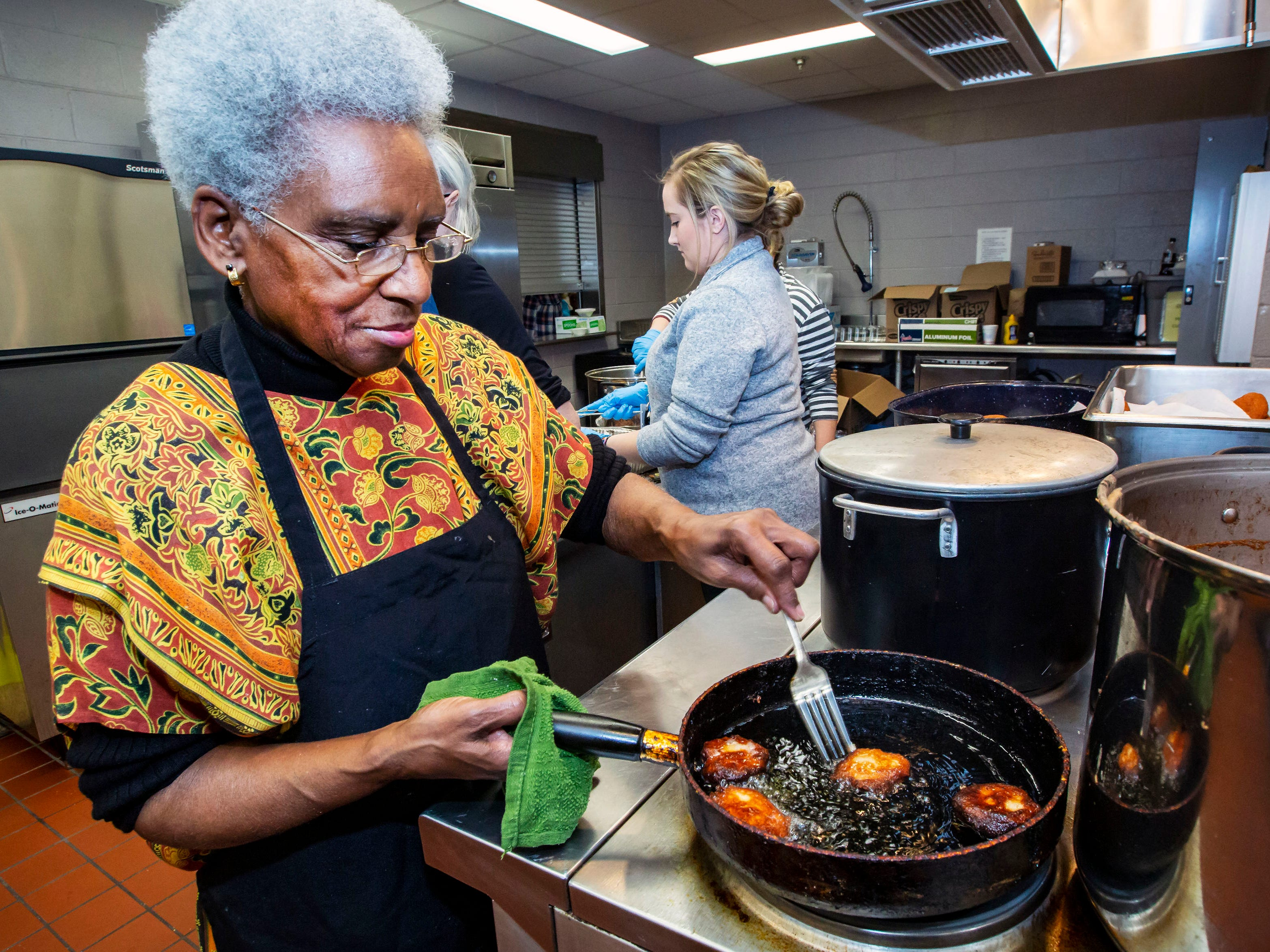 Florence Smith cooks cornbread at the African-American Cultural Celebration held at Patterson Park Community Center.