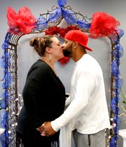 Kimberly (Ervin) Aiden and Shermaine Aiden kiss at the end of their ceremony as they are married by Mollie Slaybaugh at the Marry Me of Tennessee Wedding Chapel, in Murfreesboro, on Valentine's Day on Thursday, Feb. 14, 2019.