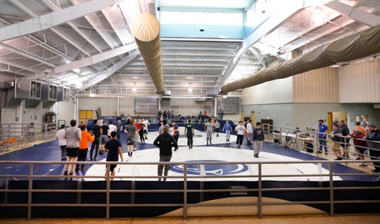 Blackman wrestling holds practice in the Lane Agri-Park Livestock barn on Wednesday, Feb. 13, 2019 as wrestling teams from Eagleville and Bartlett High Schools also practice with them.