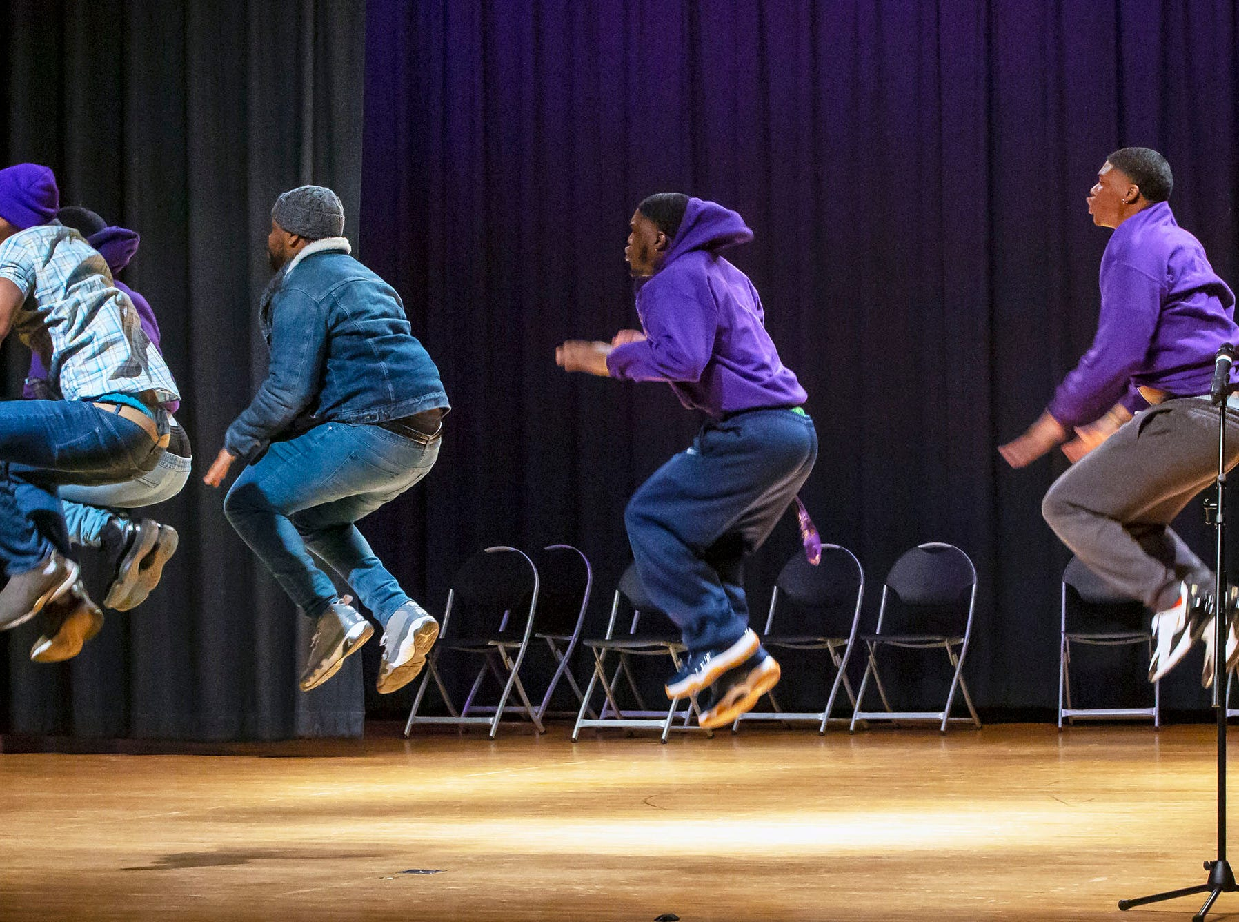 Members of the Omeha Psi Phi fraternity at MTSU perform at the African-American Cultural Celebration held at Patterson Park Community Center.