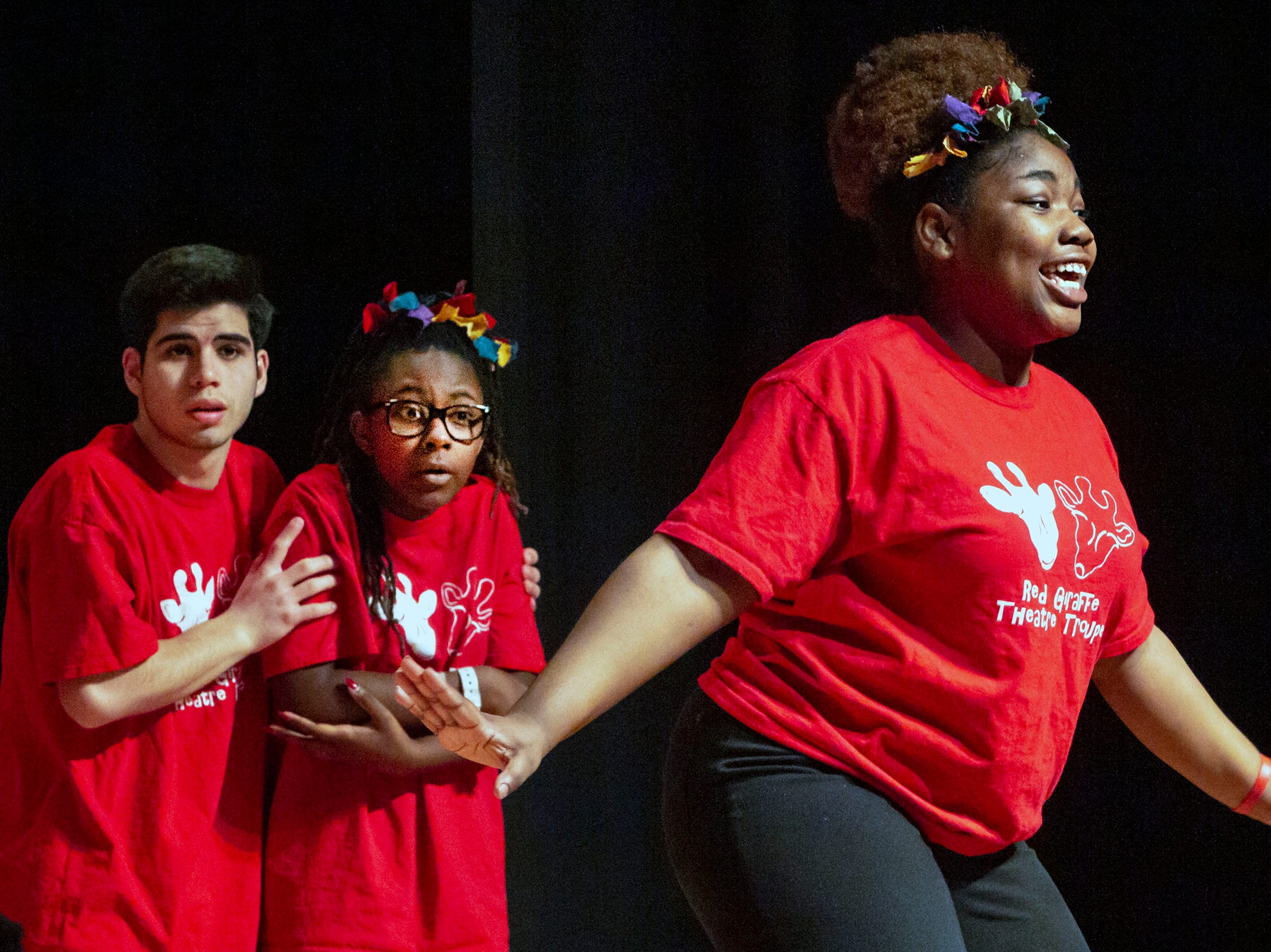 Bradley Academy Red Giraffe Theater Troupe perform at the African-American Cultural Celebration held at Patterson Park Community Center.