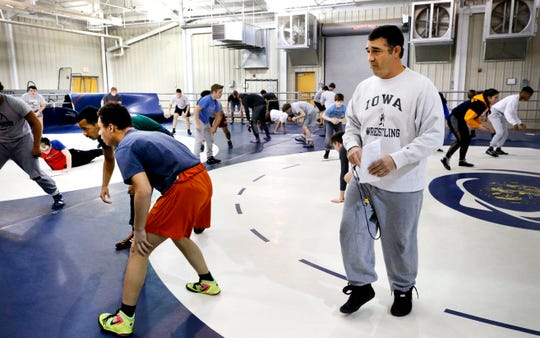 Former Blackman assistant wrestling coach Eric Sacharczyk is shown during a 2019 practice. Sacharczyk will take over the Riverdale wrestling program next season.