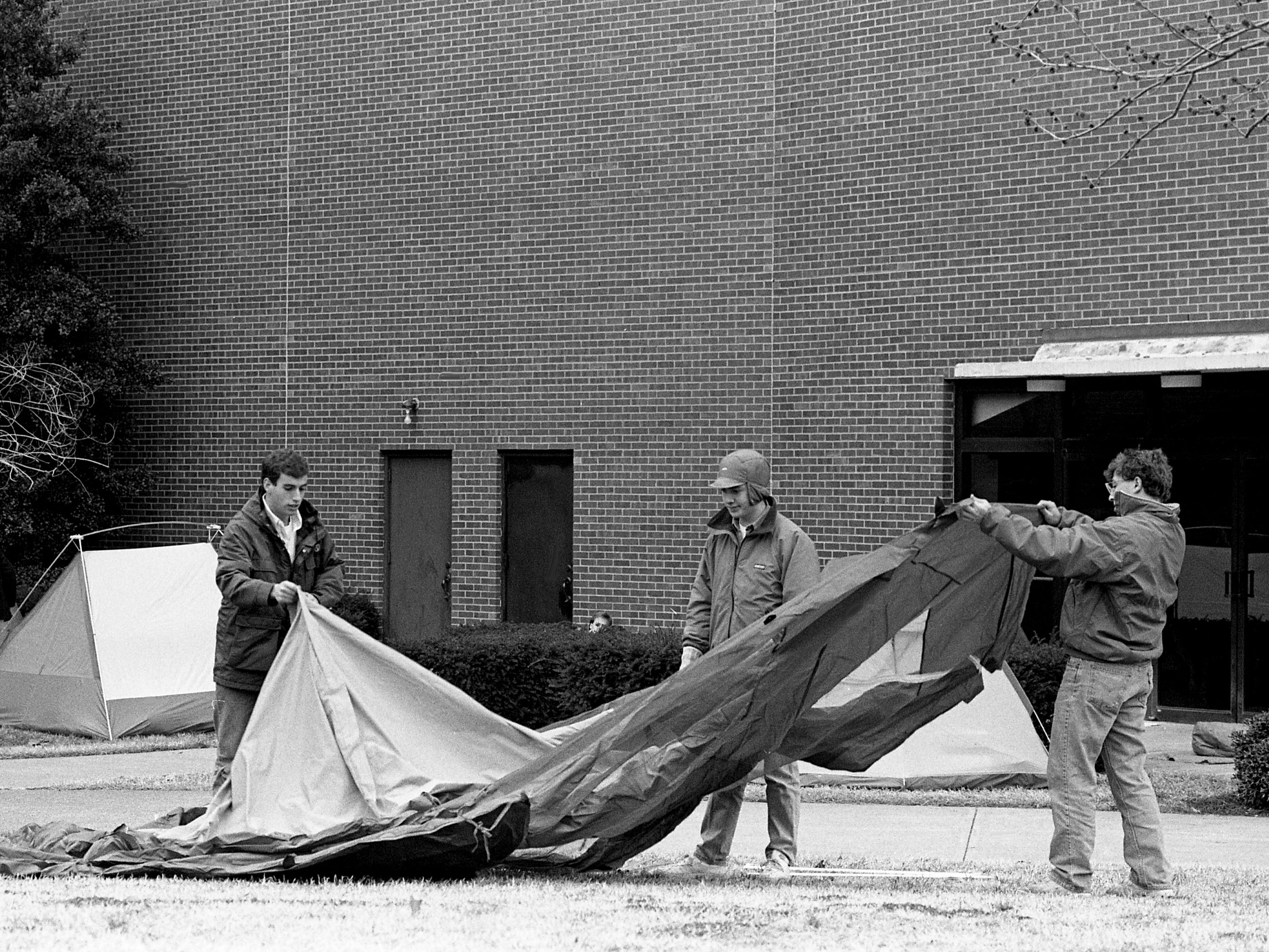 Neither rain nor sleet Feb. 4, 1989, could keep these basketball fans from pitching tents along with rolling out sleeping bags to wait for tickets for the Vanderbilt vs. Kentucky game to go on sale the next day.