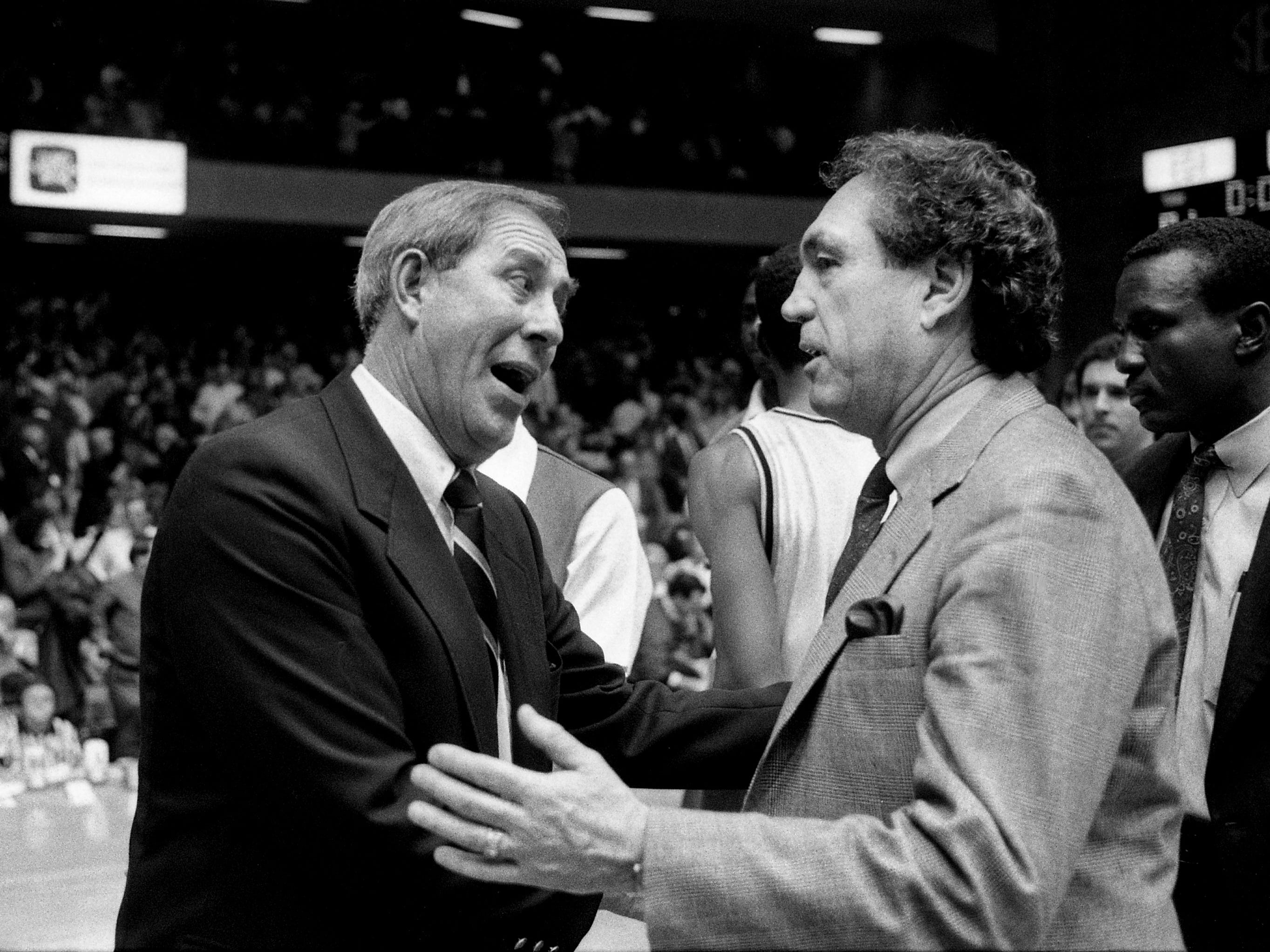 Vanderbilt head coach C.M. Newton, left, who recently announced he will become the athletic director for Kentucky, chats with Kentucky head coach Eddie Sutton after the Commodores' 81-51 victory over Kentucky before 15,646 at Memorial Gym on Feb. 8, 1989.