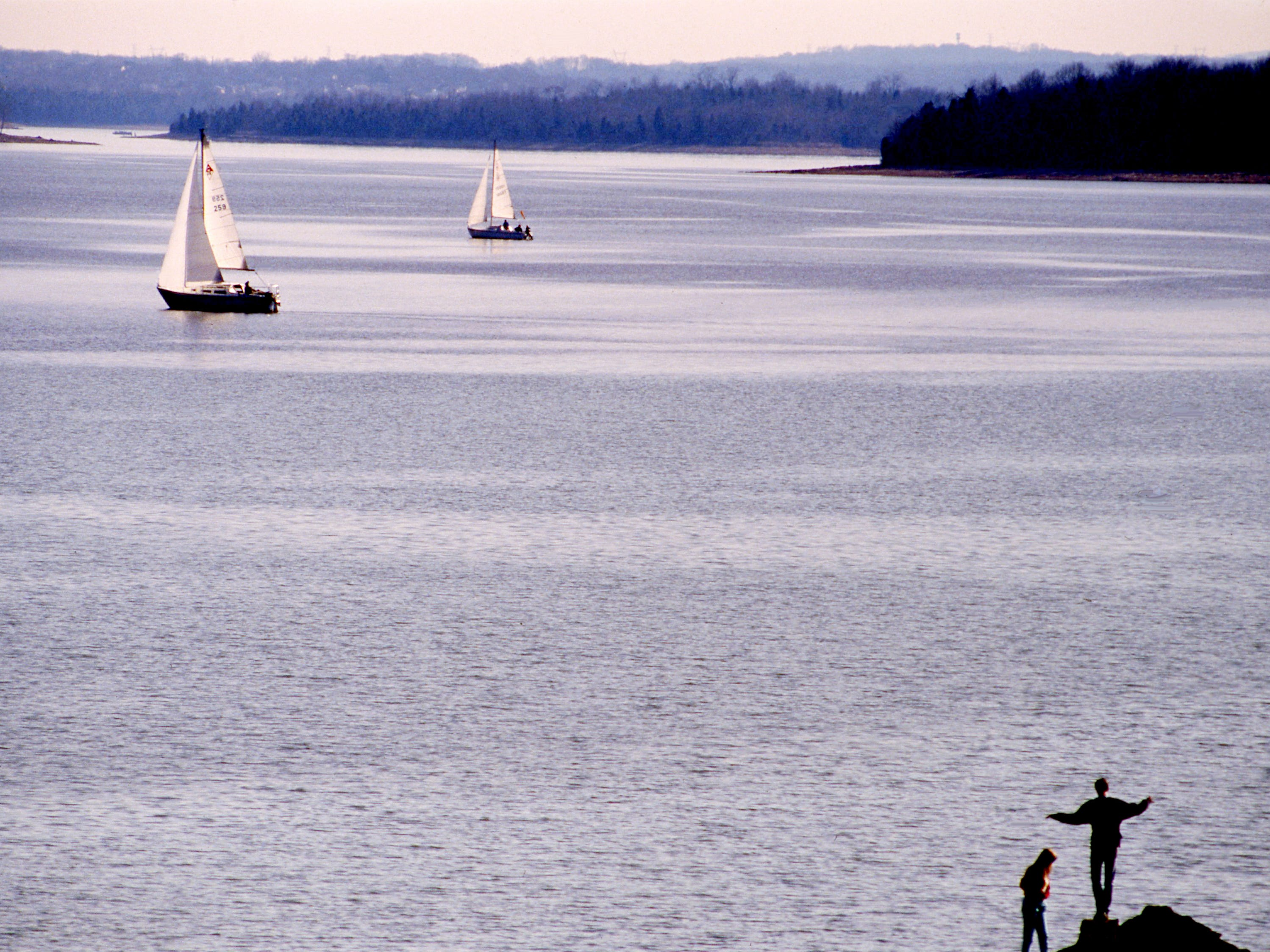 Sailboaters and beachcombers enjoy the unseasonably warm weather and gentle breezes at J. Percy Priest Lake on Feb. 12, 1989.