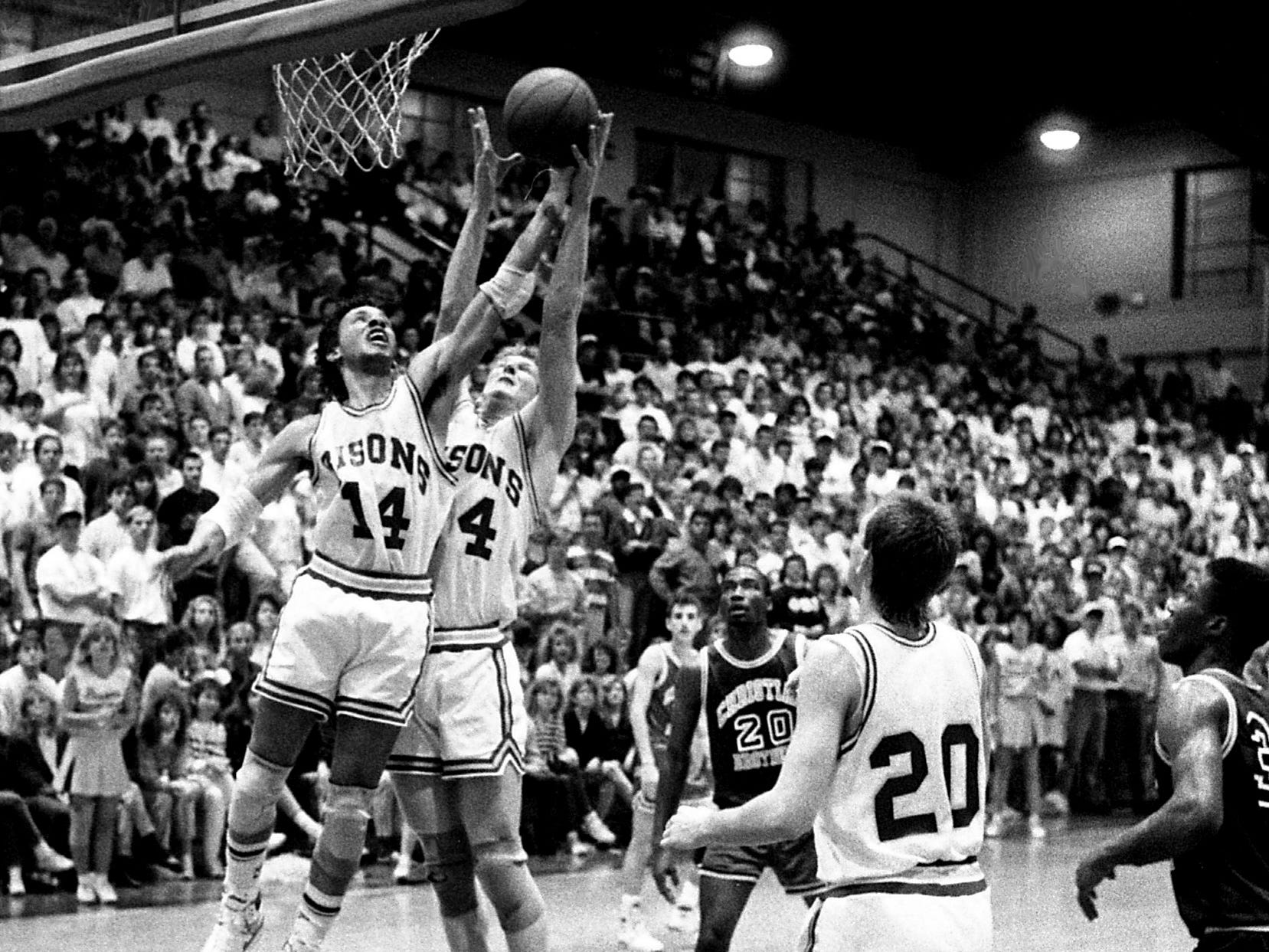 David Lipscomb teammates Marcus Bodie (14) and Philip Hutcheson battle for a rebound as the nation's No. 1-ranked NAIA team defeated Christian Brothers of Memphis 103-91 before 3,300 at McQuiddy Gym on Feb. 2, 1989, to extend its winning streak to 31 games.