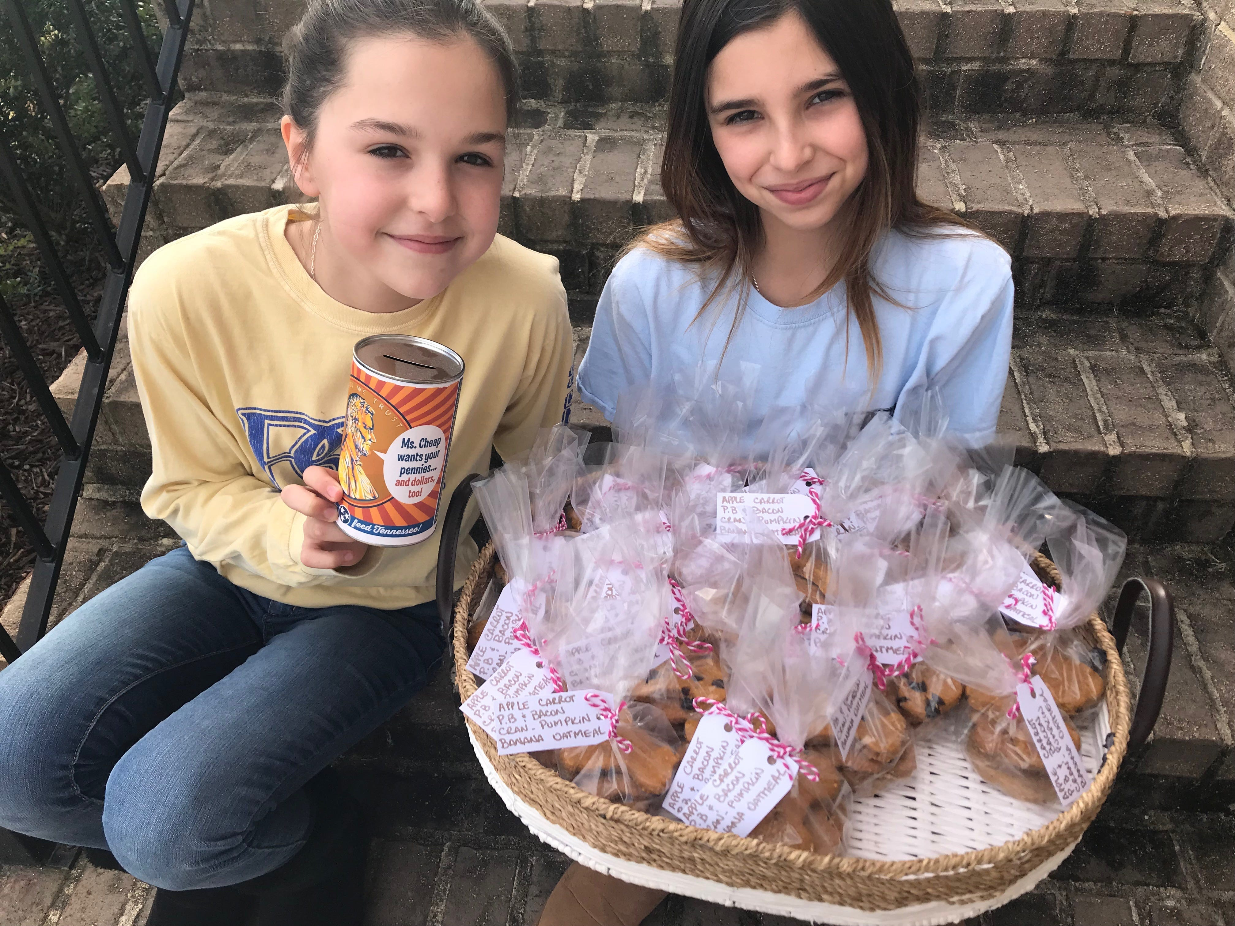 Twins Mia (left) and Zoe (right) Hawkersmith made and sold dog treats in their neighborhood! They collected $470.