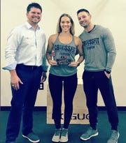 Fairview Chamber president Joel Moenkhoff with Chris and Fawn Purky Miller owners of the new CrossFit in Fairview.