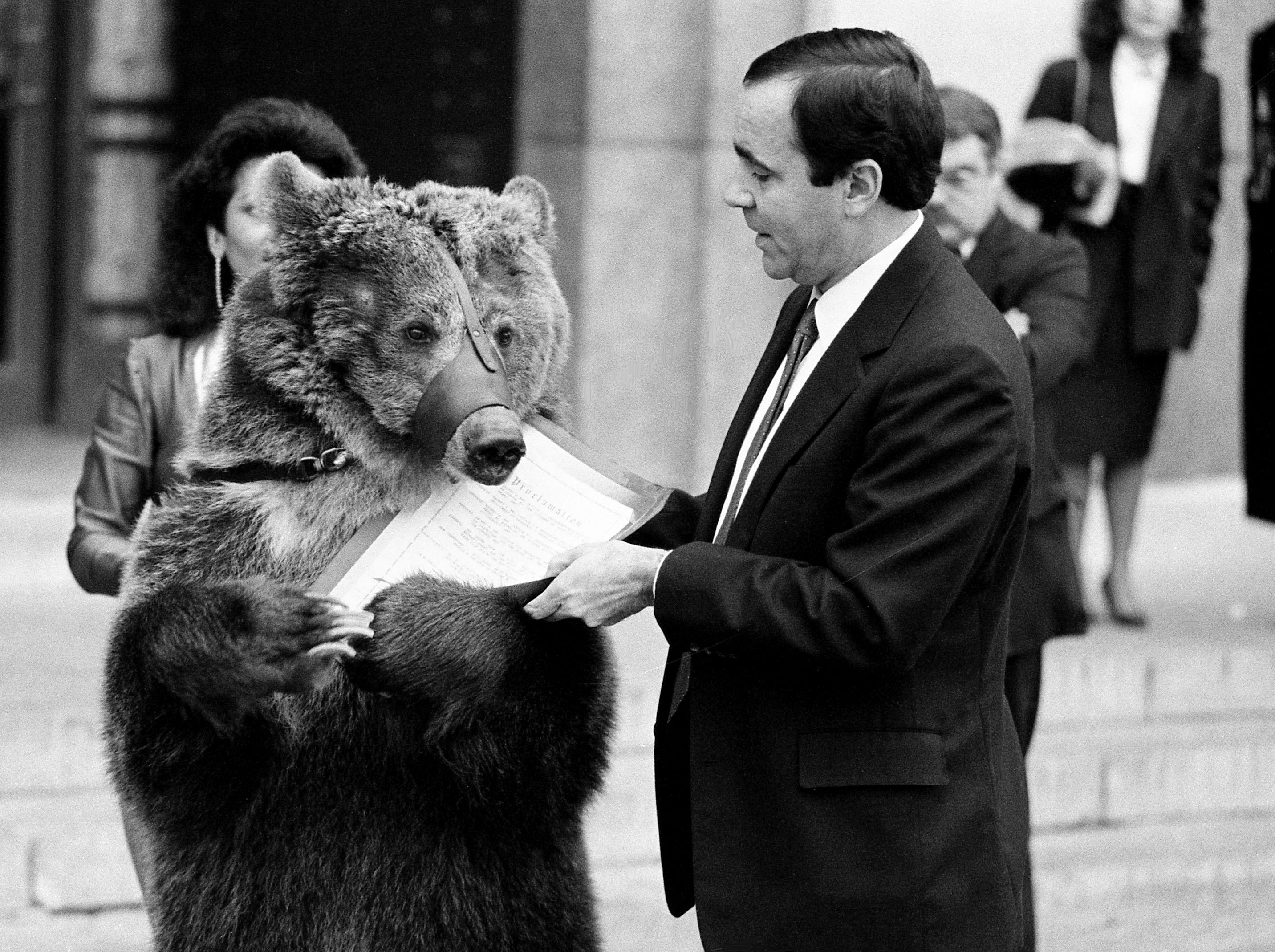 Emma the bear, doing promotional work for the Shoney's Circus, which will perform the coming weekend at Municipal Auditorium, finds the proclamation presented by Metro Mayor Bill Boner in front of the Metro Courthouse a tasty treat Feb. 21, 1989.